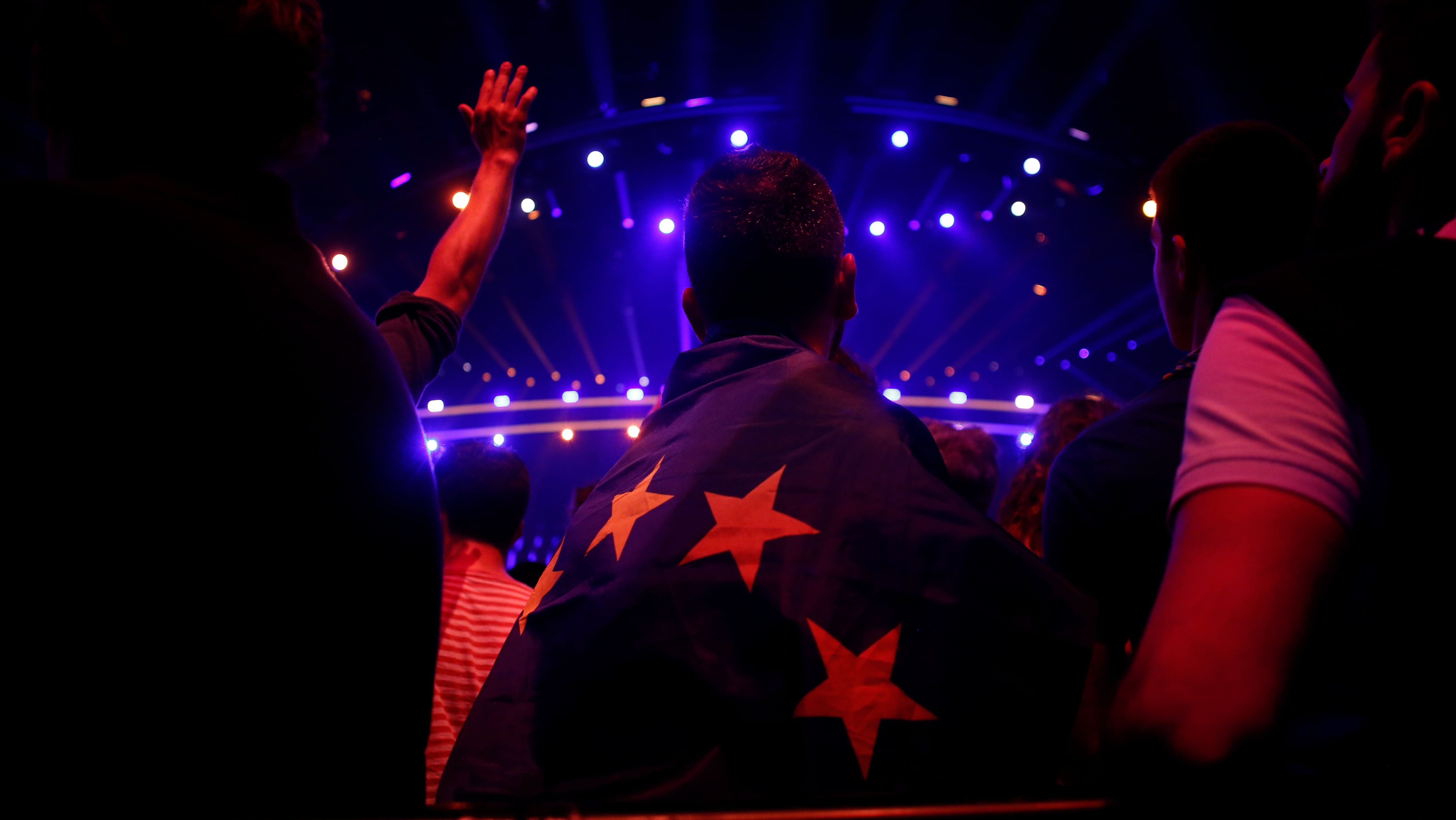 A spectator wears an European flag during the Eurovision Song Contest 2018 at the Altice Arena hall in Lisbon, Portugal, on May 10, 2018.
