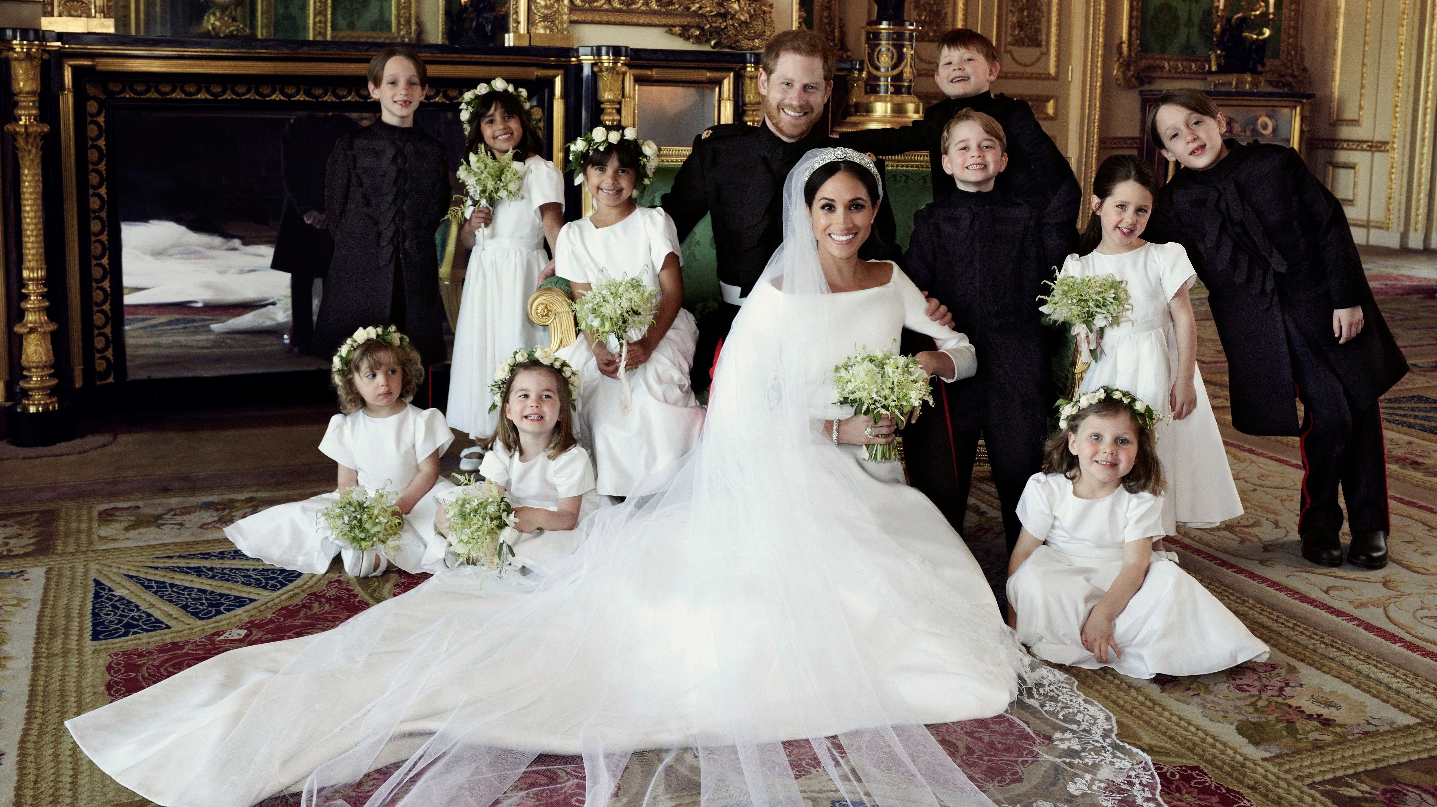 This official wedding photograph released by the Duke and Duchess of Sussex shows The Duke and Duchess in The Green Drawing Room, Windsor Castle, with (left-to-right): Back row: Master Brian Mulroney, Miss Remi Litt, Miss Rylan Litt, Master Jasper Dyer, Prince George, Miss Ivy Mulroney, Master John Mulroney. Front row: Miss Zalie Warren, Princess Charlotte, Miss Florence van Cutsem, on May 19, 2018.