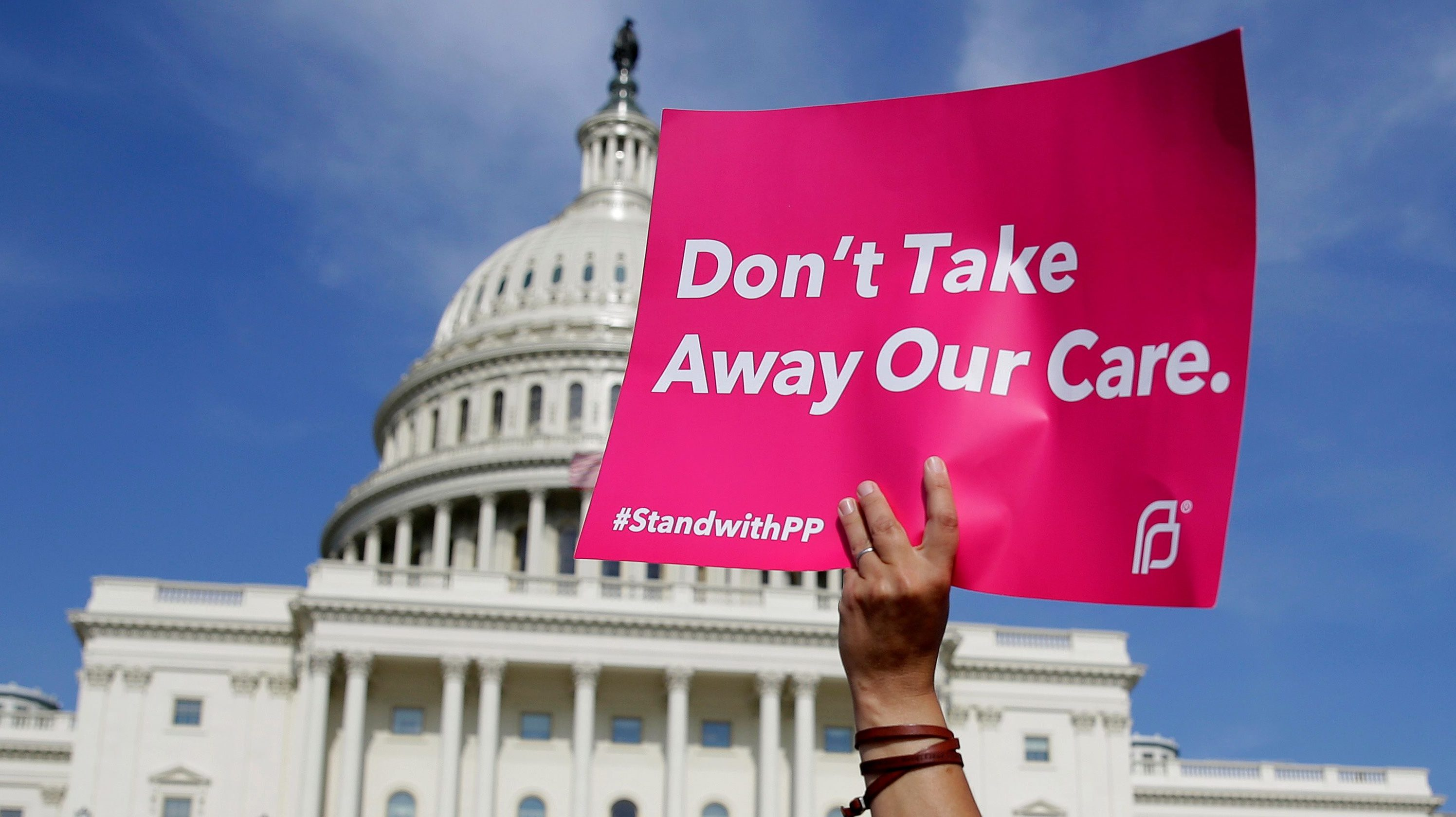 Healthcare activists with Planned Parenthood and the Center for American Progress protest in opposition to the Senate Republican healthcare bill on Capitol Hill on June 28, 2017.