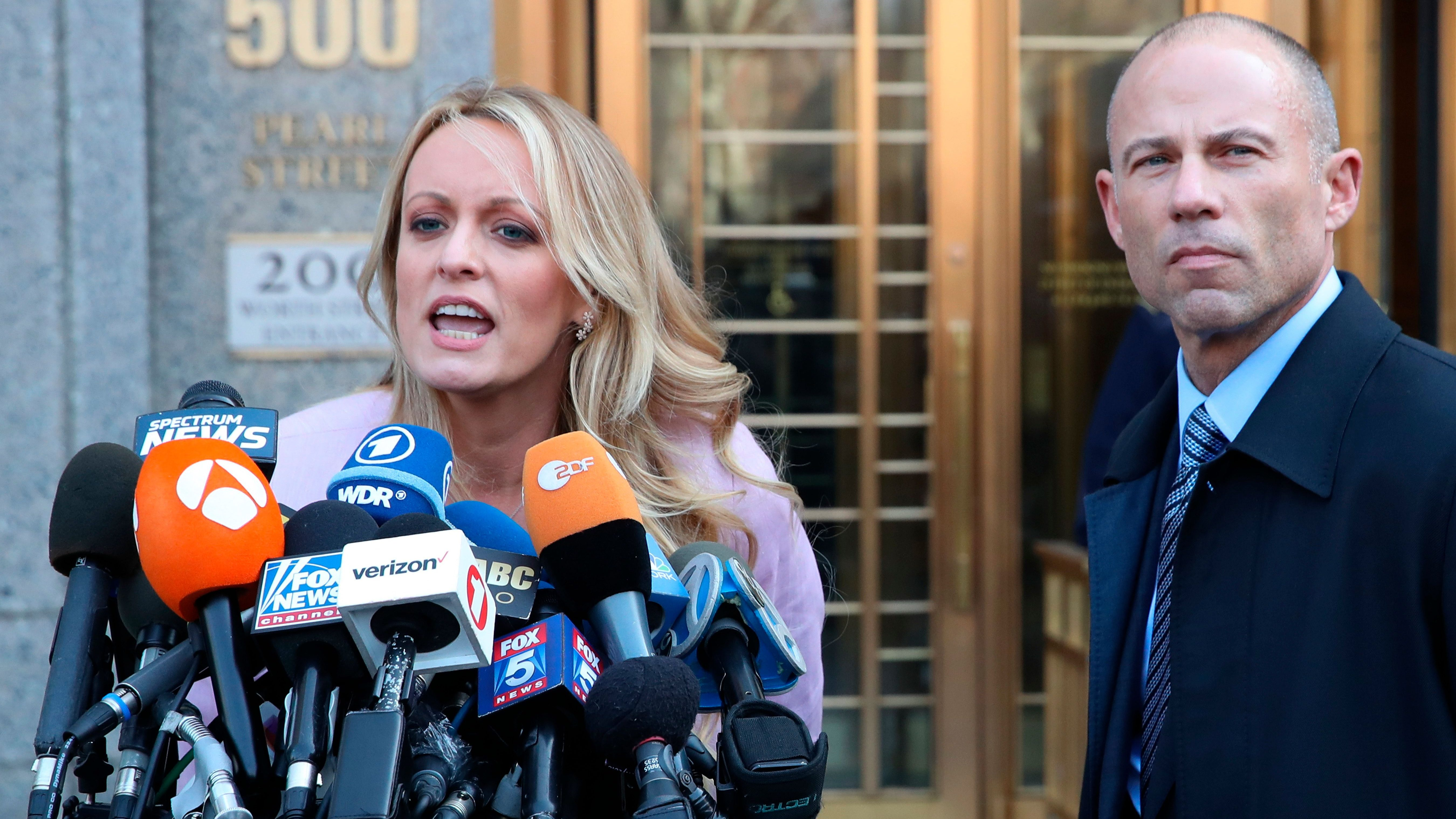 Porn actress Stormy Daniels, accompanied by her attorney, Michael Avenatti, right, talks to the media as she leaves federal court, Monday, April 16, 2018 in New York. A U.S. judge listened to more arguments about President Donald Trump's extraordinary request that he be allowed to review records seized from his lawyer, Michael Cohen, office as part of a criminal investigation before they are examined by prosecutors. (AP Photo/Mary Altaffer)