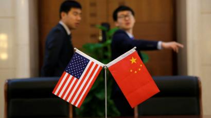 Chinese and U.S. flags are set up for a signing ceremony during a visit by U.S. Secretary of Transportation Elaine Chao at China's Ministry of Transport in Beijing