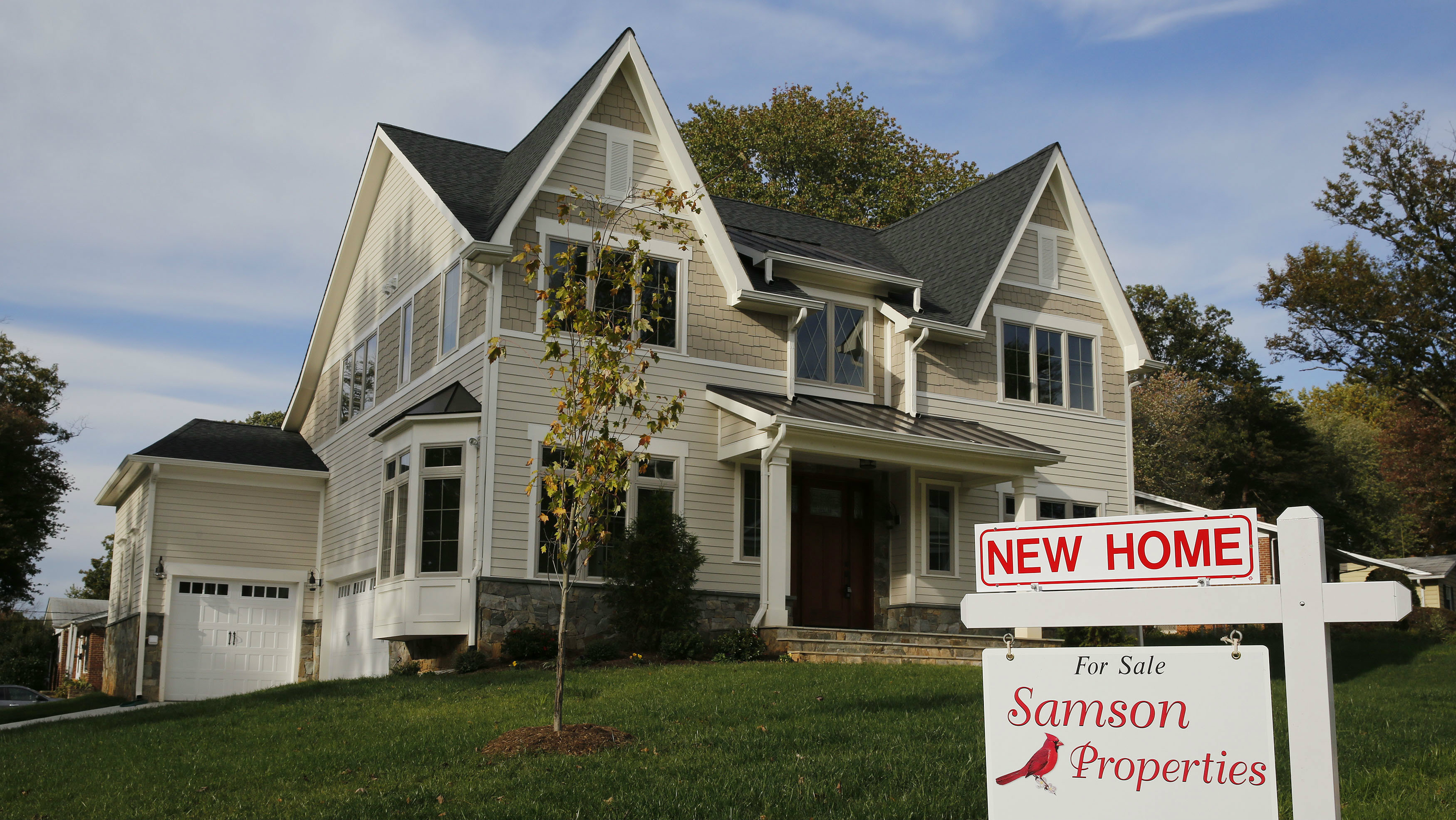 A real estate sign advertising a new home for sale is pictured in Vienna, Virginia, US