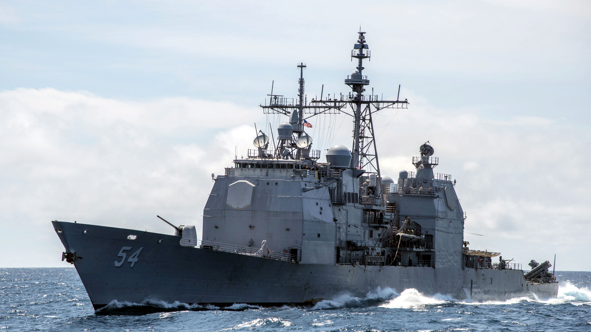 """FILE - This Mar. 6, 2016, file photo provided by the U.S. Navy, shows the Ticonderoga-class guided-missile cruiser USS Antietam (CG 54) sails in the South China Sea. China says it dispatched warships to identify and warn off a pair of U.S. Navy vessels sailing near one of its island claims in the South China Sea. A statement on the Defense Ministry's website said the Arleigh Burke class guided-missile destroyer USS Higgins and Ticonderoga class guided-missile cruiser USS Antietam entered waters China claims in the Paracel island group """"without the permission of the Chinese government."""""""