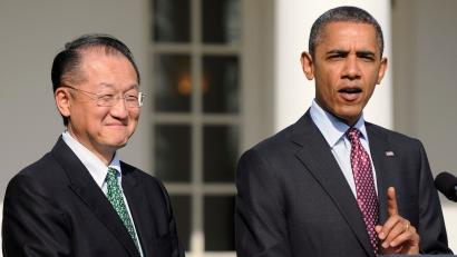 U.S. President Barack Obama (R) makes a point about Dartmouth College president Jim Yong Kim (L) as he introduces him as his nominee to be the next president of the World Bank, during an announcement in the Rose Garden at the White House in Washington, March 23, 2012.