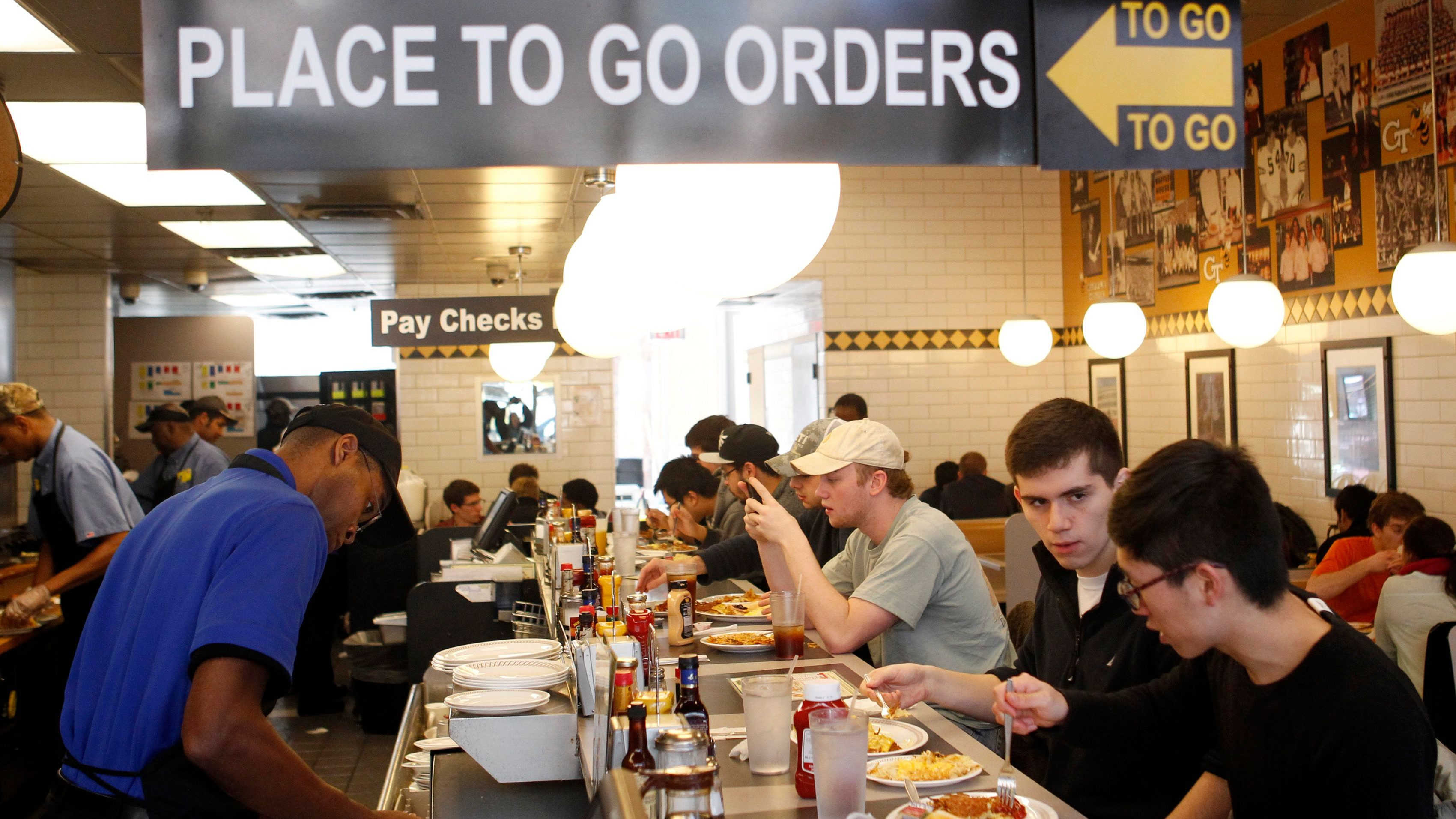 Customers pack a front counter at a Waffle House after spending two days cooped up due to an ice storm in downtown Atlanta