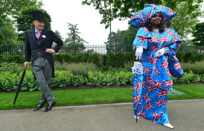 A racegoer wearing a union flag inspired outfit arrives for Ladies' Day at the Royal Ascot horse racing festival at Ascot