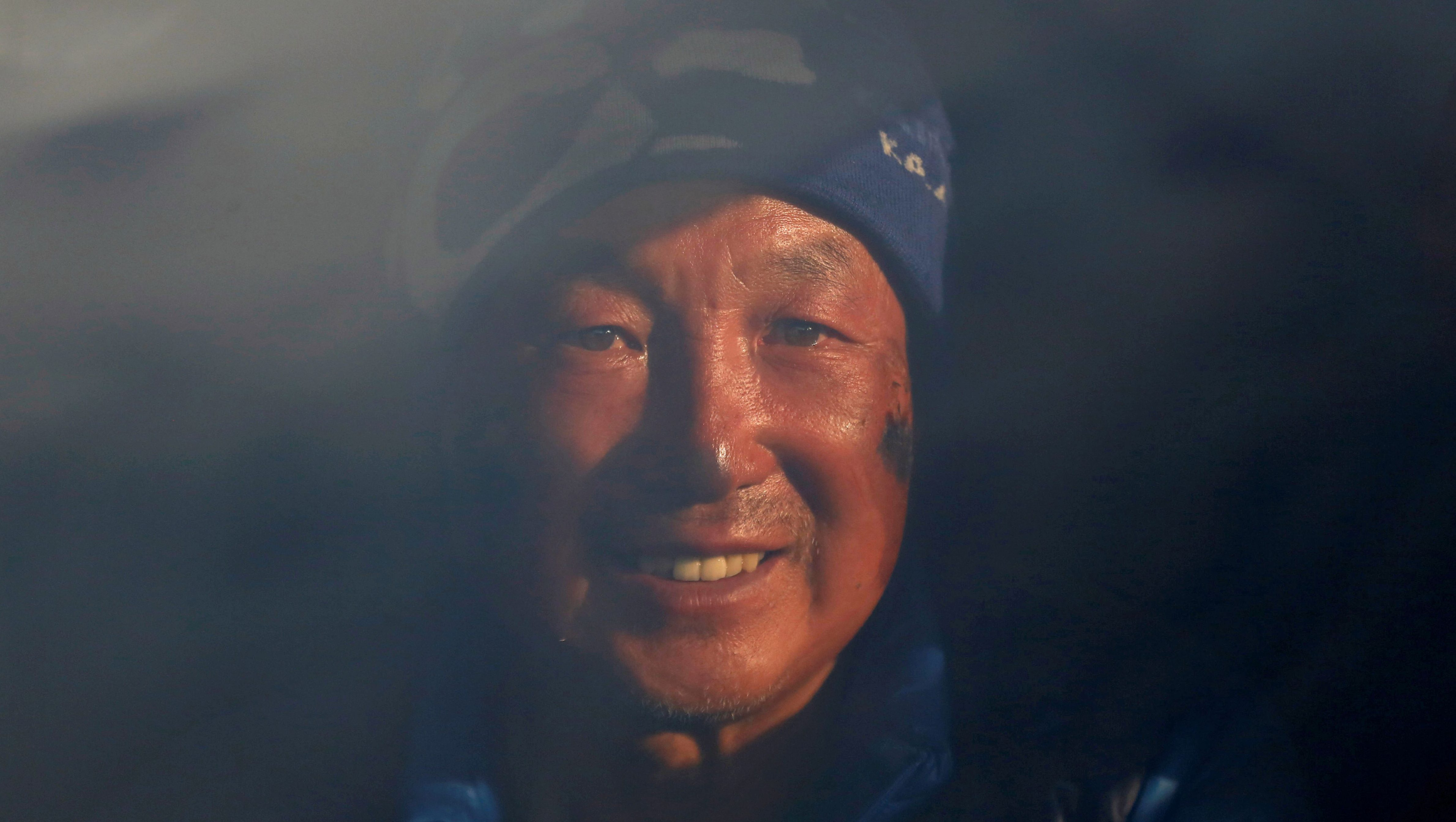 Xia Boyu, a Chinese double amputee climber, who lost both of his legs during his first attempt to climb Everest, smiles as he sits on an ambulance upon his arrival, after successfully climbing Mount Everest, in Kathmandu, Nepal May 16, 2018. REUTERS/Navesh Chitrakar TPX IMAGES OF THE DAY - RC1E790B1E80