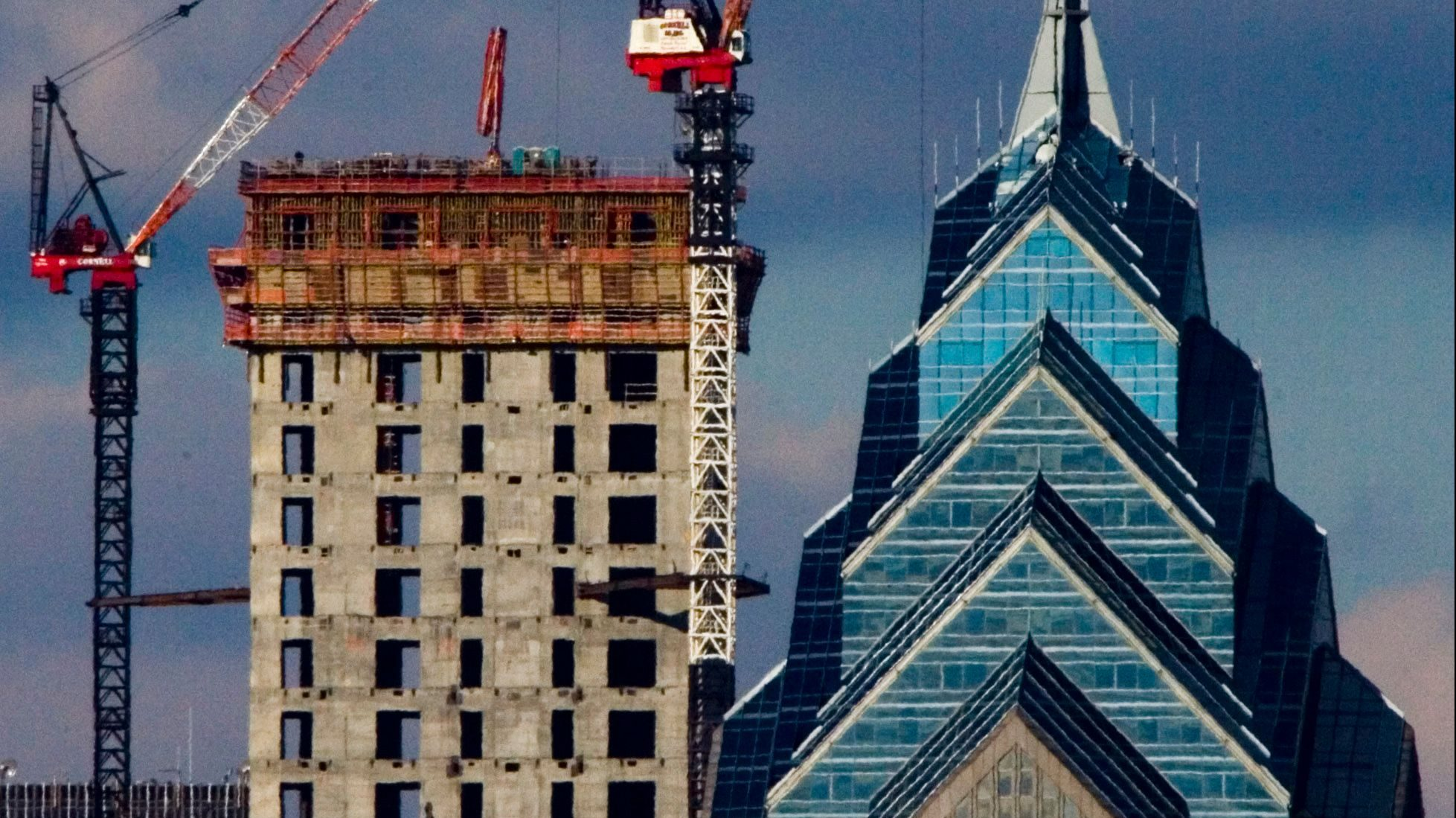 The concrete core of the rising Comcast Center skyscraper, left, is shown with One Liberty Place, in Philadelphia, Tuesday, Jan. 9, 2007.  Skyscraper developers are increasingly installing safety features in light of the Sept. 11 attacks and it's not just happening in New York City but places such as Miami, San Francisco and Philadelphia.