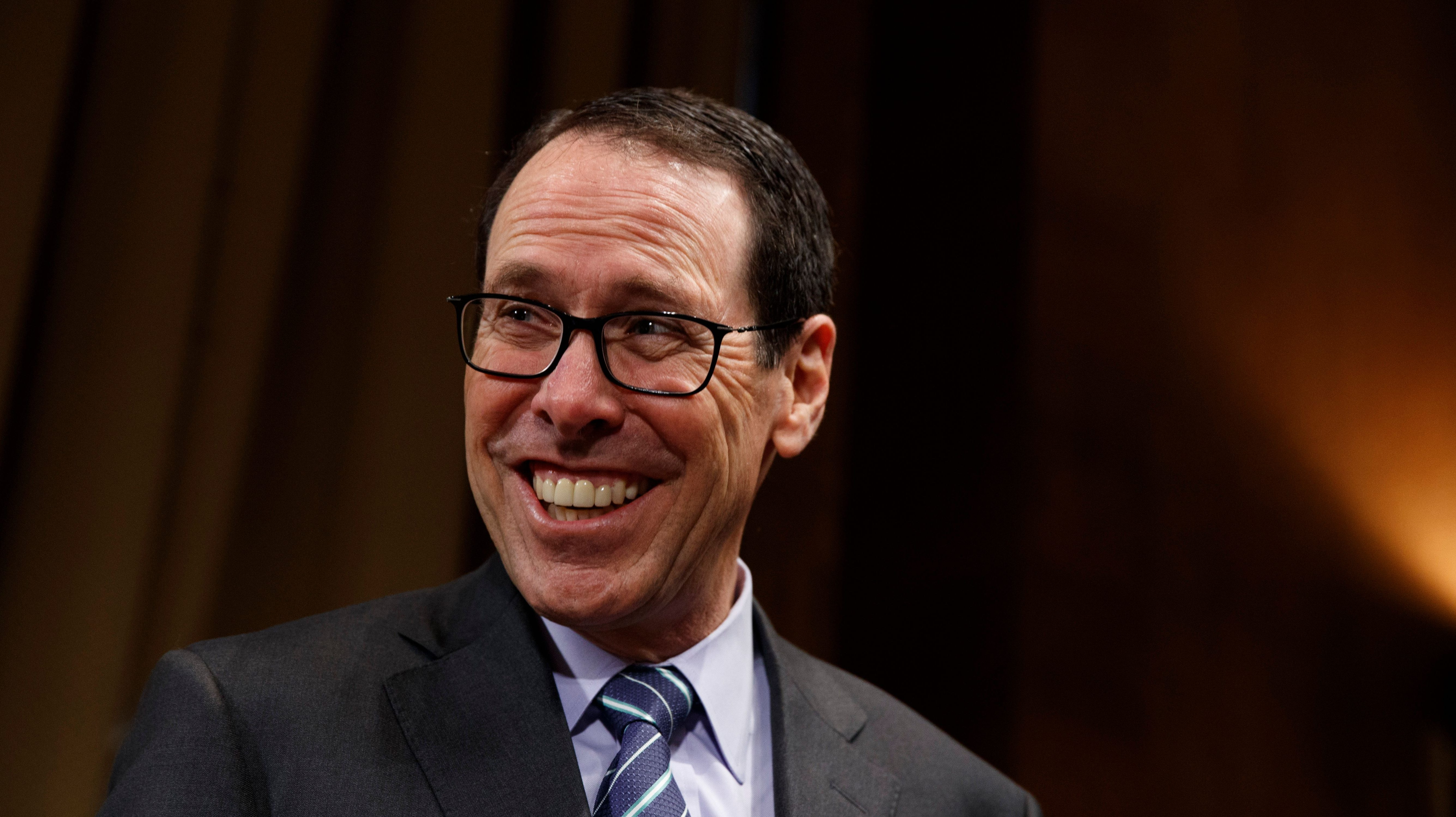 AT&T Chairman and CEO Randall Stephenson smiles on Capitol Hill in Washington, Wednesday, Dec. 7, 2016, prior to testifying before a Senate Judiciary subcommittee hearing on the proposed merger between AT&T and Time Warner. (AP Photo/Evan Vucci)