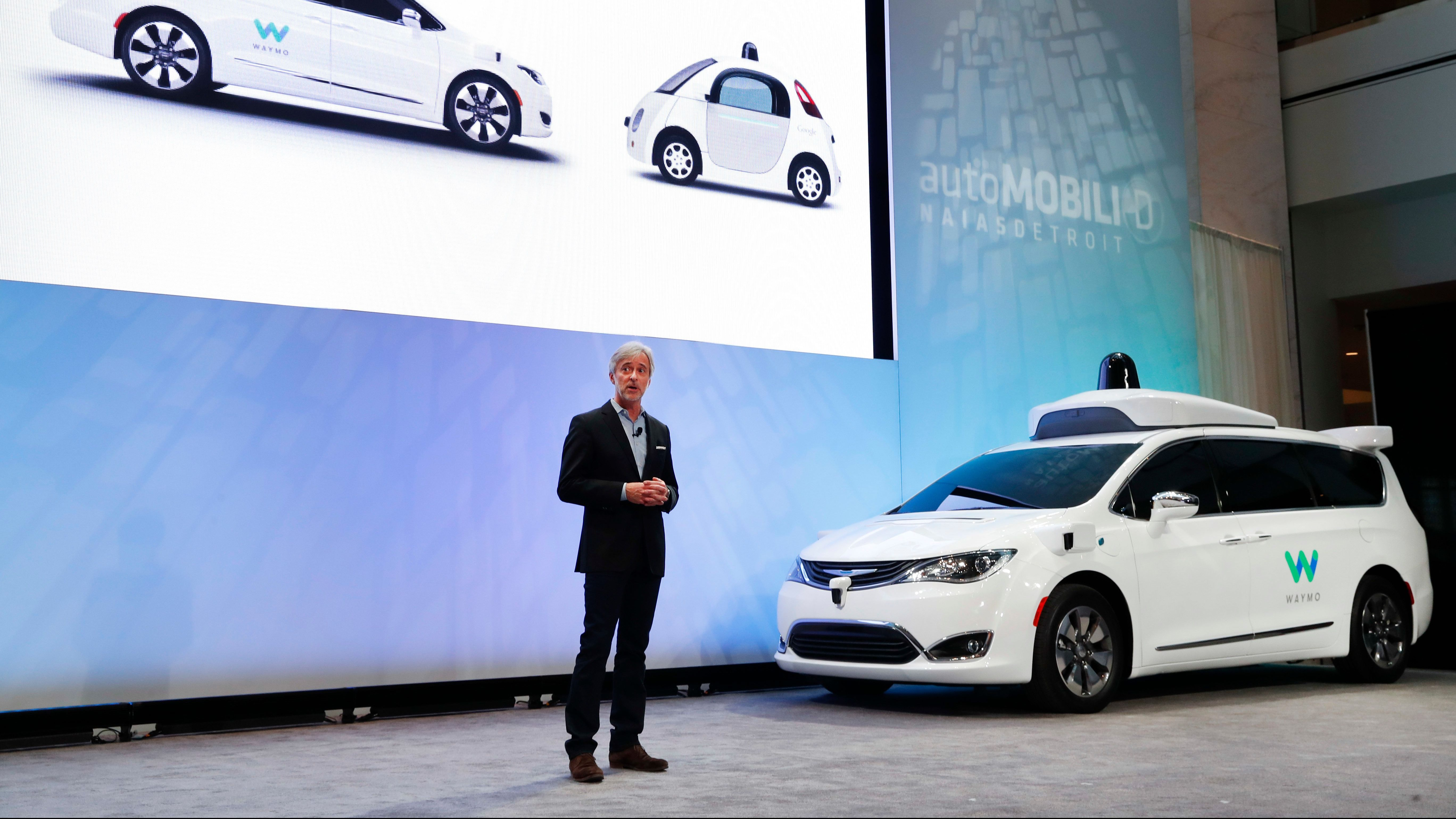 John Krafcik, CEO of Waymo Inc., the autonomous vehicle company created by Google's parent company, introduces a Chrysler Pacifica hybrid outfitted with Waymo's own suite of sensors and radar at the North American International Auto Show in Detroit, Sunday, Jan. 8, 2017.