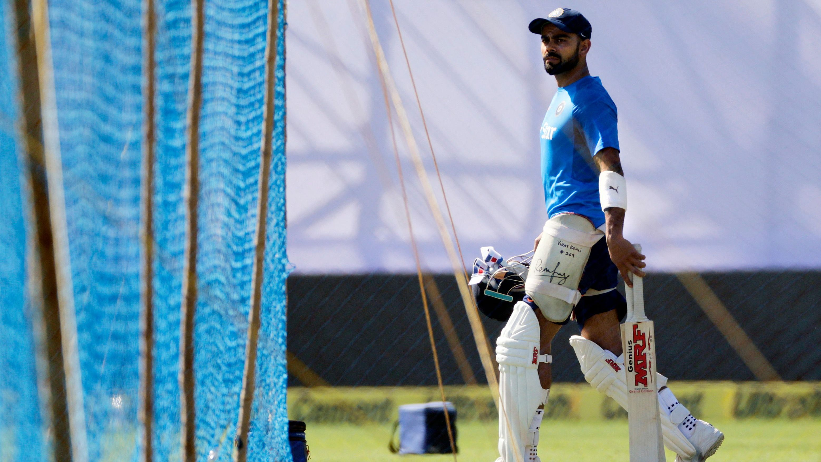 India's captain Virat Kohli returns after batting during a practice session ahead of their first cricket test match against Australia in Pune, India, Wednesday, Feb. 22, 2017. (AP Photo/Rajanish Kakade)