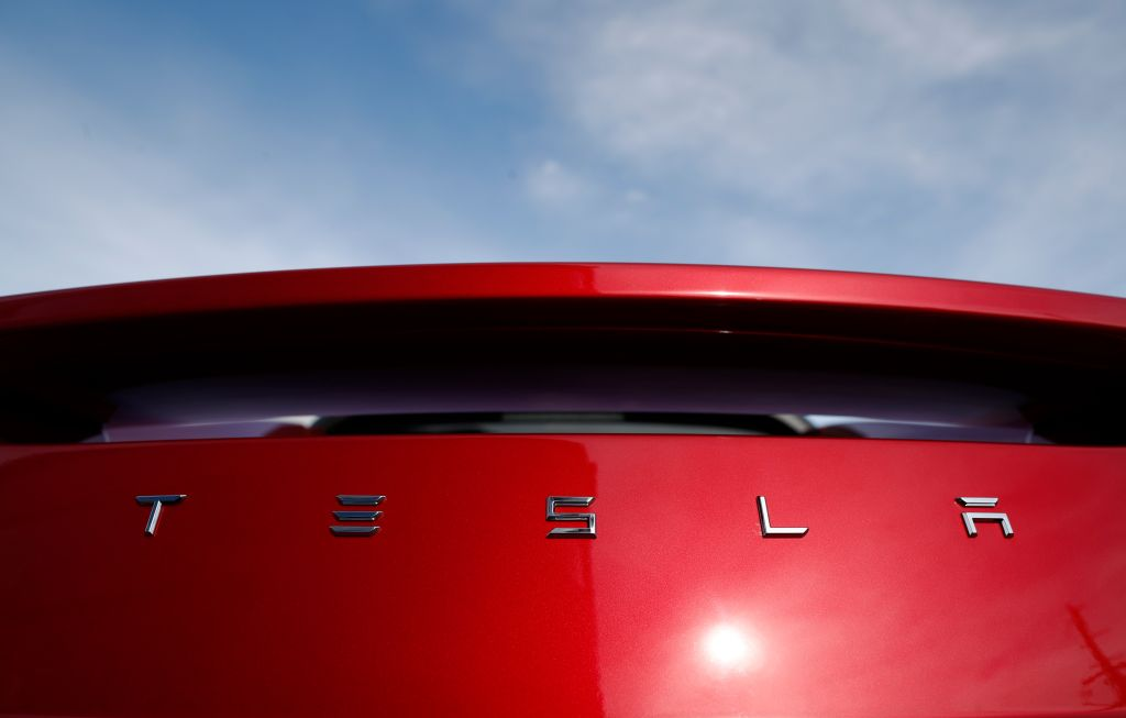 FILE- In this April 15, 2018, photo, the sun shines off the rear deck of a roadster on a Tesla dealer's lot in the south Denver suburb of Littleton, Colo. For years, Tesla has boasted that its cars and SUVs are safer than other vehicles on the roads, and CEO Elon Musk doubled down on the claims in a series of tweets this week. (AP Photo/David Zalubowski, File)