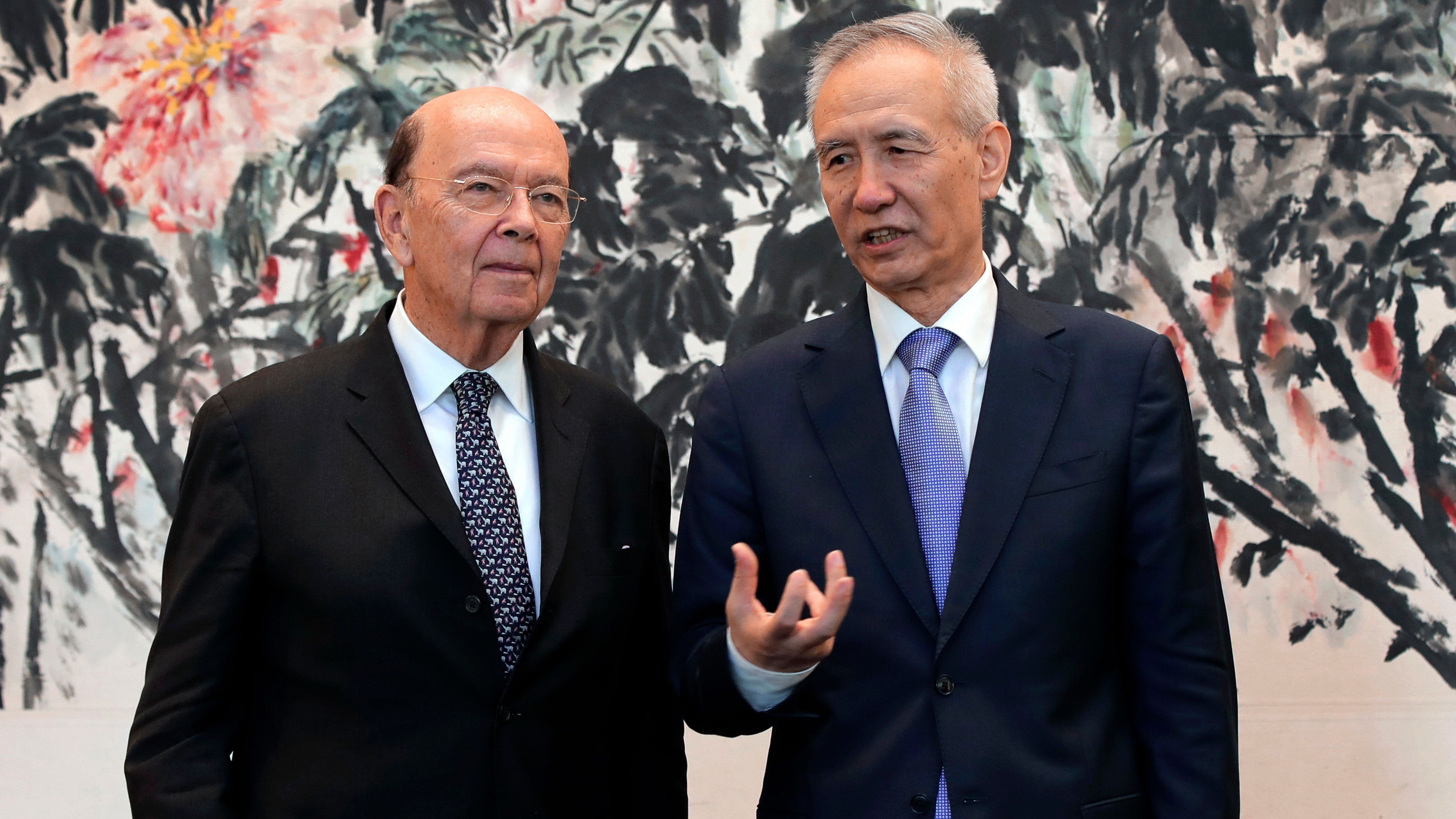 U.S. Commerce Secretary Wilbur Ross, left, chats with Chinese Vice Premier Liu He during a photograph session after their meeting at the Diaoyutai State Guesthouse in Beijing, Sunday, June 3, 2018. U.S. and Chinese officials have discussed specific American export items Beijing might buy as part of its pledge to narrow its trade surplus with the United States, U.S. Commerce Secretary Ross said Sunday as the two sides began a new round of talks in Beijing aimed at settling a simmering trade dispute. (AP Photo/Andy Wong, Pool)