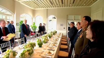 In this image made from video provided by Host Broadcaster Mediacorp Pte Ltd,, U.S. President Donald Trump, second from left, and North Korean leader Kim Jong Un, fourth from right, arrive for a working lunch at Capella Hotel in Singapore, Tuesday, June 12, 2018.