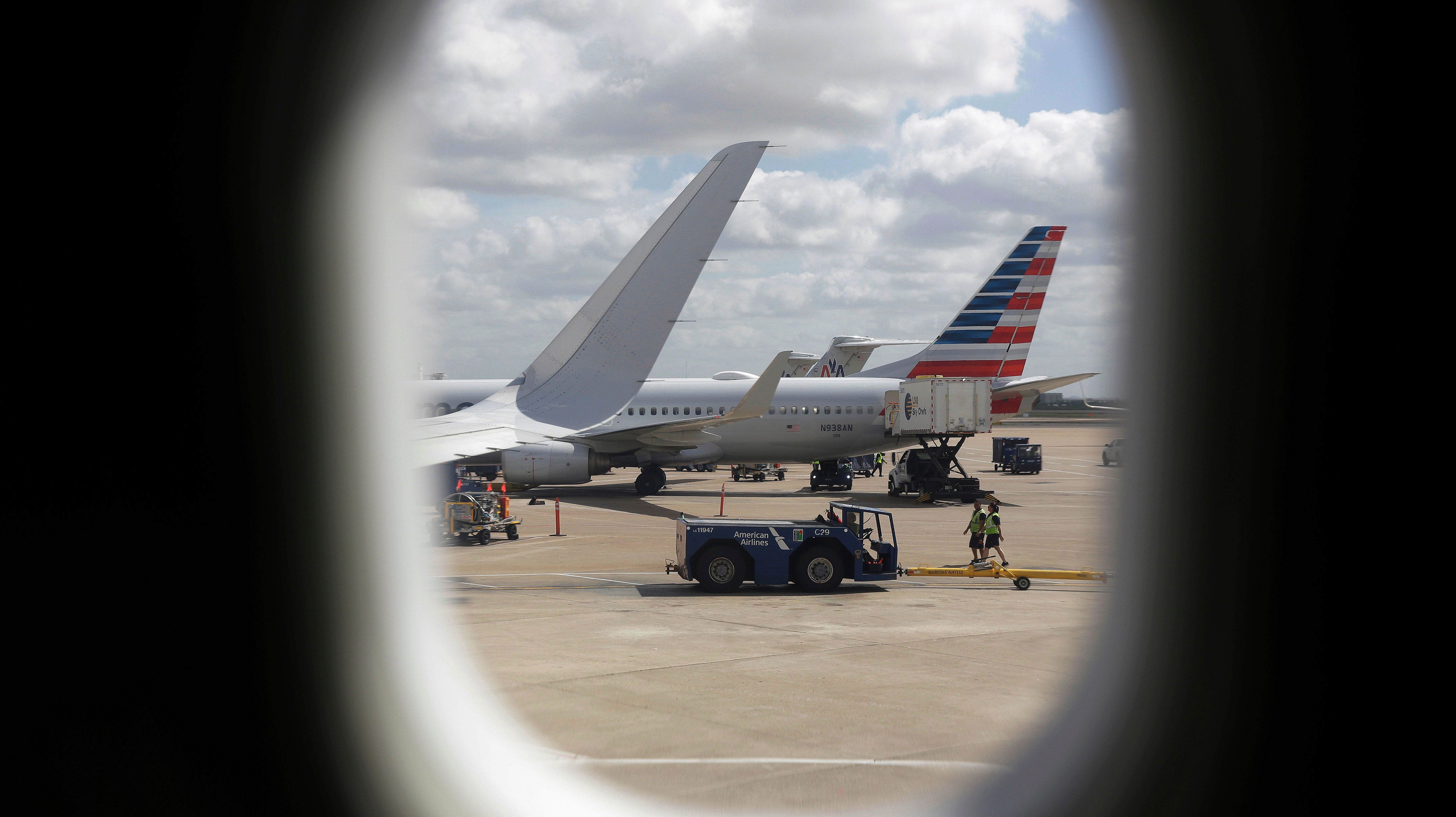"In this June 16, 2018 photo, American Airlines aircrafts aircrafts are seen at O""Hare International Airport in Chicago. (AP Photo/Kiichiro Sato)"