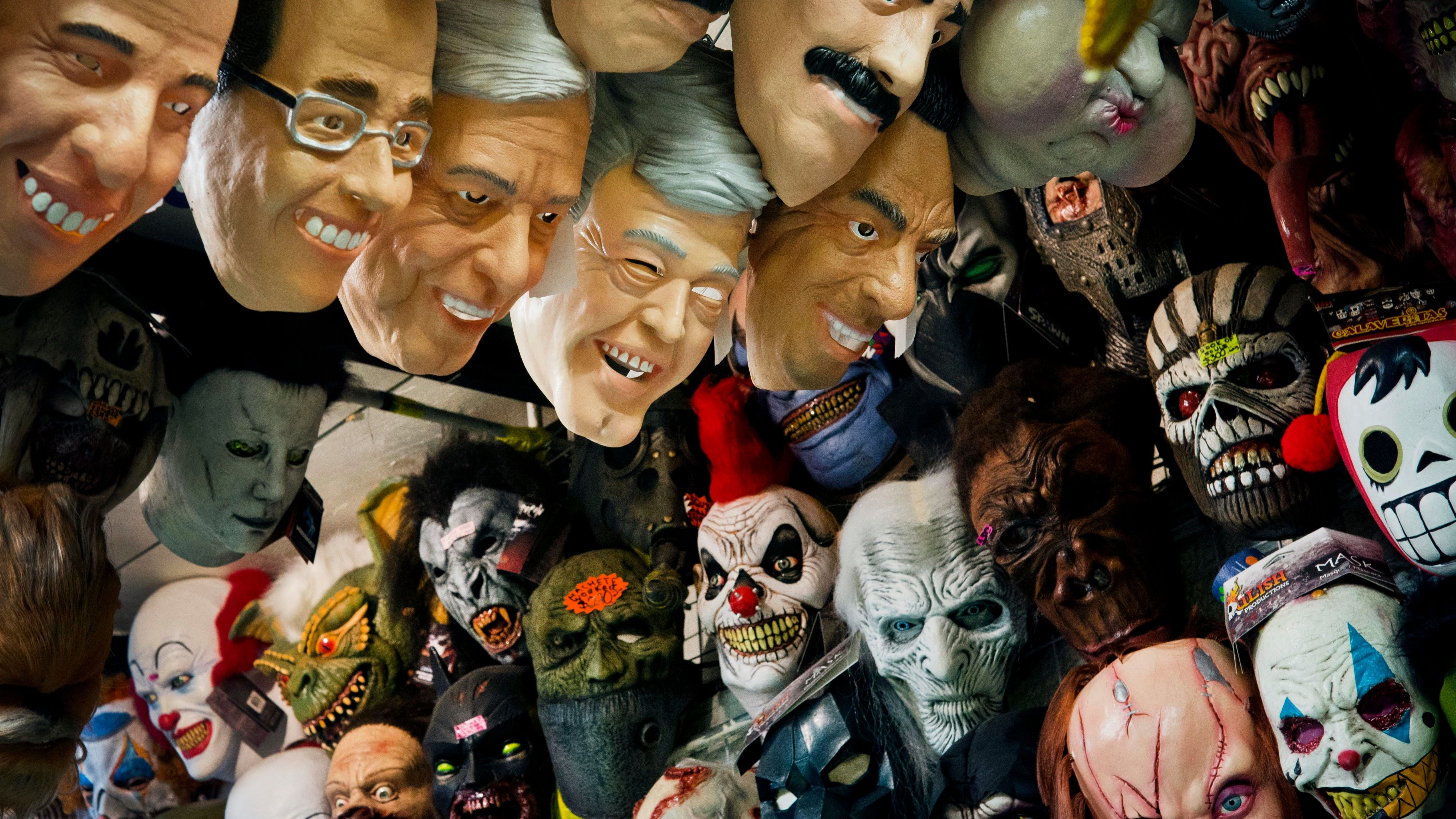 masks representing Mexican presidential candidates Jose Antonio Meade, of the Institutional Revolutionary Party (PRI), Ricardo Anaya, center, of the left-right coalition Forward for Mexico, and Andres Manuel Lopez Obrador of the Morena party are for sale at a local market in Mexico City,