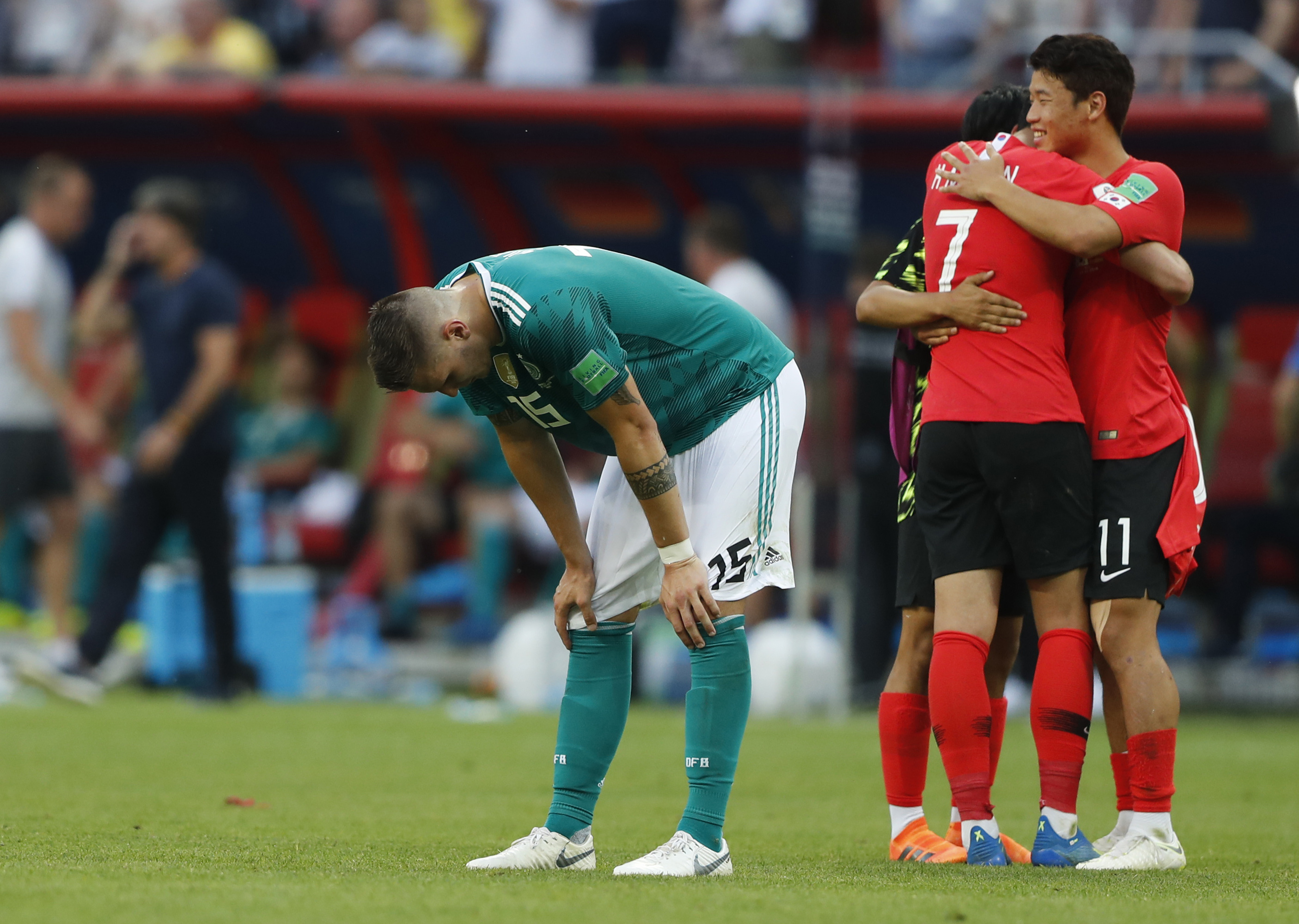 Germany's Niklas Suele, left, is dejected as South Korea's Son Heung-min, right, celebrates after the group F match between South Korea and Germany, at the 2018 soccer World Cup in the Kazan Arena in Kazan, Russia, Wednesday, June 27, 2018. South Korea won the match 2-0.