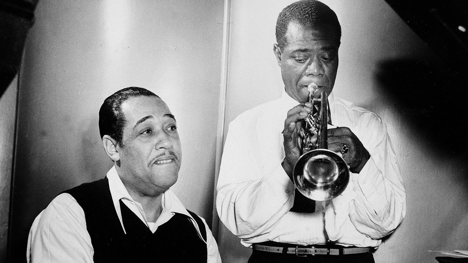 """Duke Ellington at the piano and Louis Armstrong on trumpet rehearse Leonard Feather's """"Long, Long Journey"""" during a session at the RCA Victor recording studio in New York, Jan. 12, 1946. (AP Photo)"""