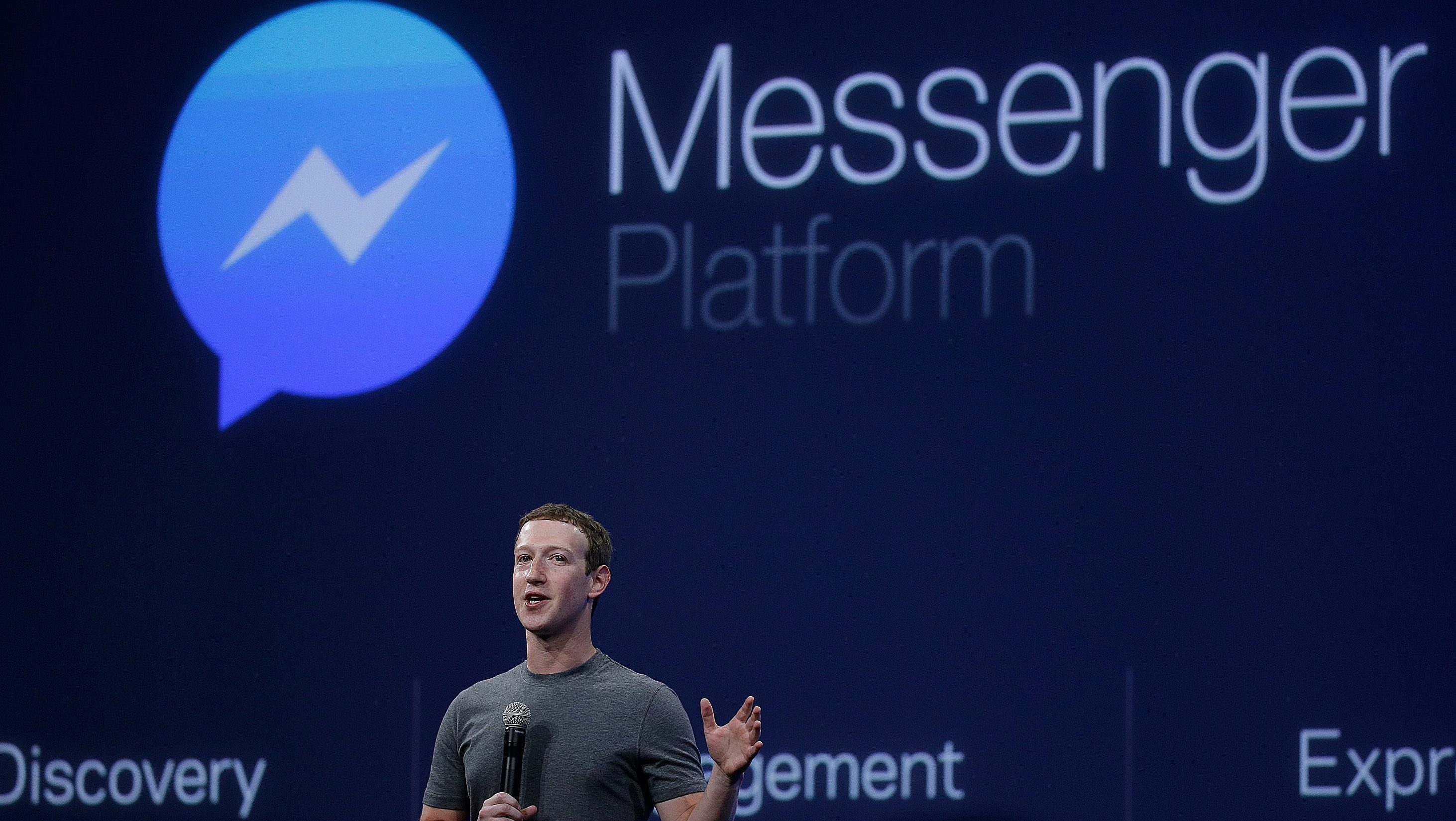 CEO Mark Zuckerberg talks about the Messenger app during the Facebook F8 Developer Conference Wednesday, March 25, 2015, in San Francisco. Facebook is trying to mold its Messenger app into a more versatile communications channel as smartphones create new ways for people to connect with friends and businesses beyond the walls of the company's ubiquitous social network. (AP Photo/Eric Risberg)