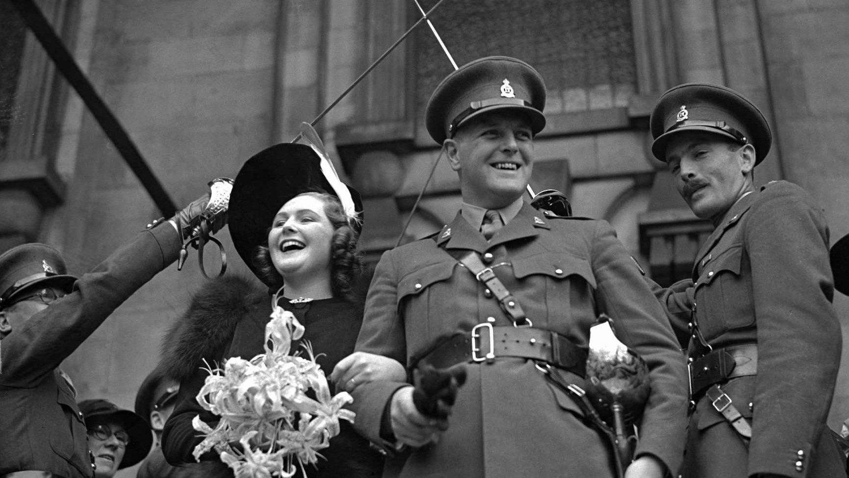 U.S. Ambassador to France Pamela Harriman, then Pamela Digby, and her first husband Randolph Churchill, son of Britain's World War II Prime Minister Sir Winston Churchill, leave St. John's Church in London's Smith Square after their wedding on October 4 1939.