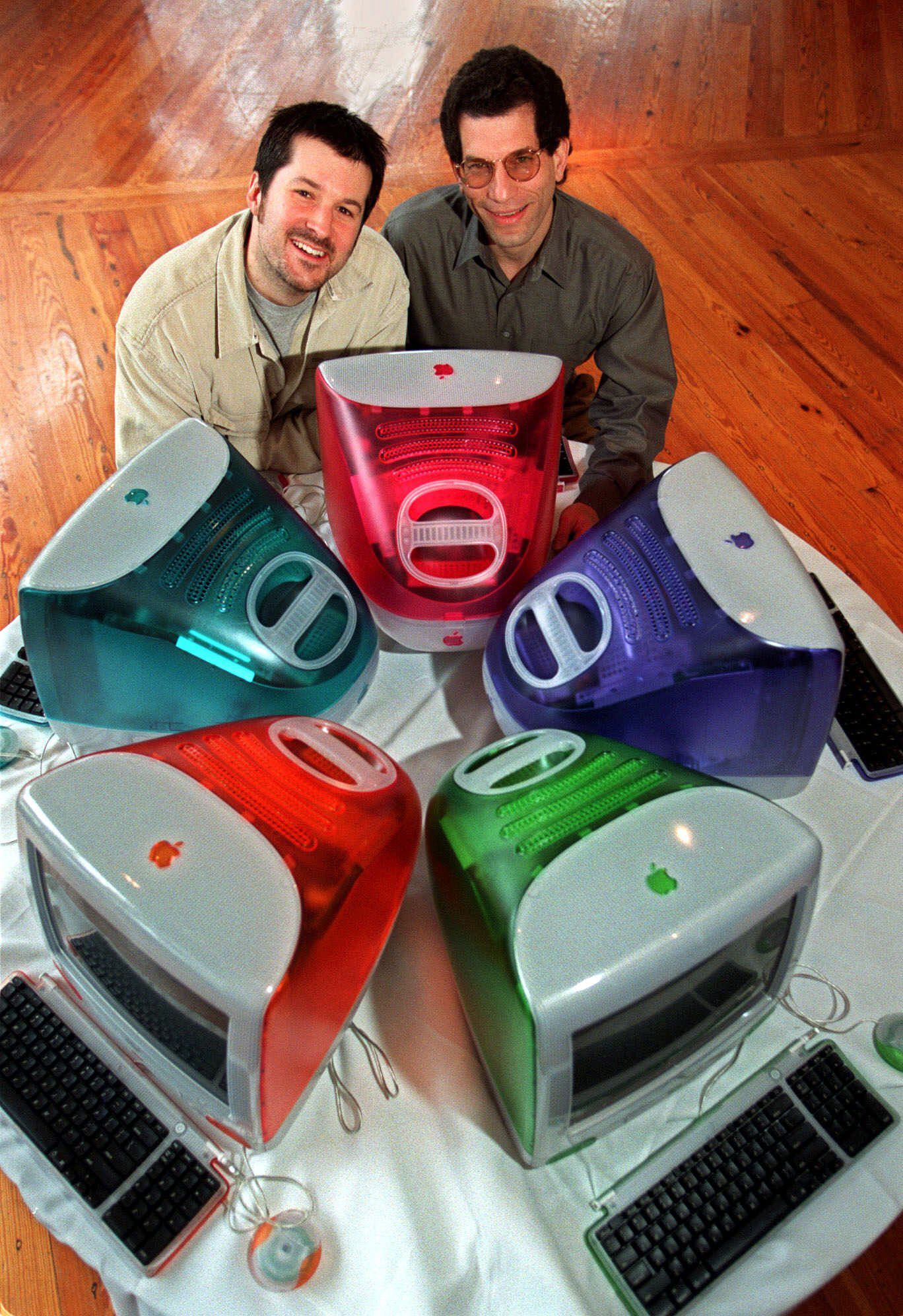 FILE - In this file photo taken March 19, 1999, Jonathan Ive, left, Apple's vice president of design, and Jon Rubinstein, Apple's senior vice president of engineering, pose behind five iMac personal computers, at Apple headquarters in Cupertino, Calif. Apple CEO Steve Jobs may be the company's most recognizable personality, but much of its cachet comes from its clean, friendly-looking designs _ the product of its head designer, Jonathan Ive. (AP Photo/Susan Ragan, File)