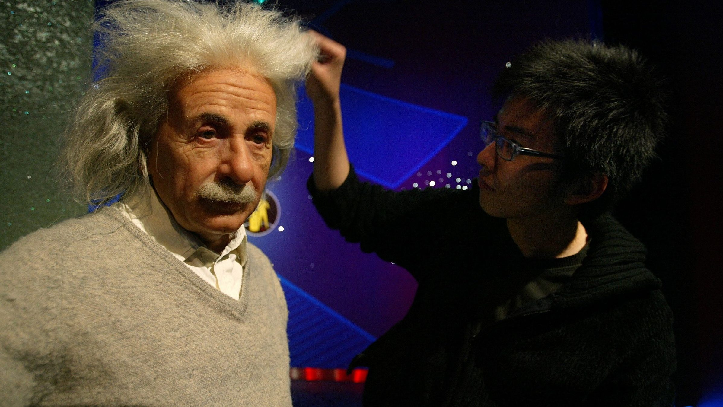 An artist adjust the hair on a wax model of mathematician Albert Einstein at the Madame Tussaud's Wax Museum in Shanghai April 28, 2006. The museum is due to open on May 1, 2006 and will display more than 70 wax models, among them representations of a number of Chinese politicians and celebrities. - PBEAHUNODEN
