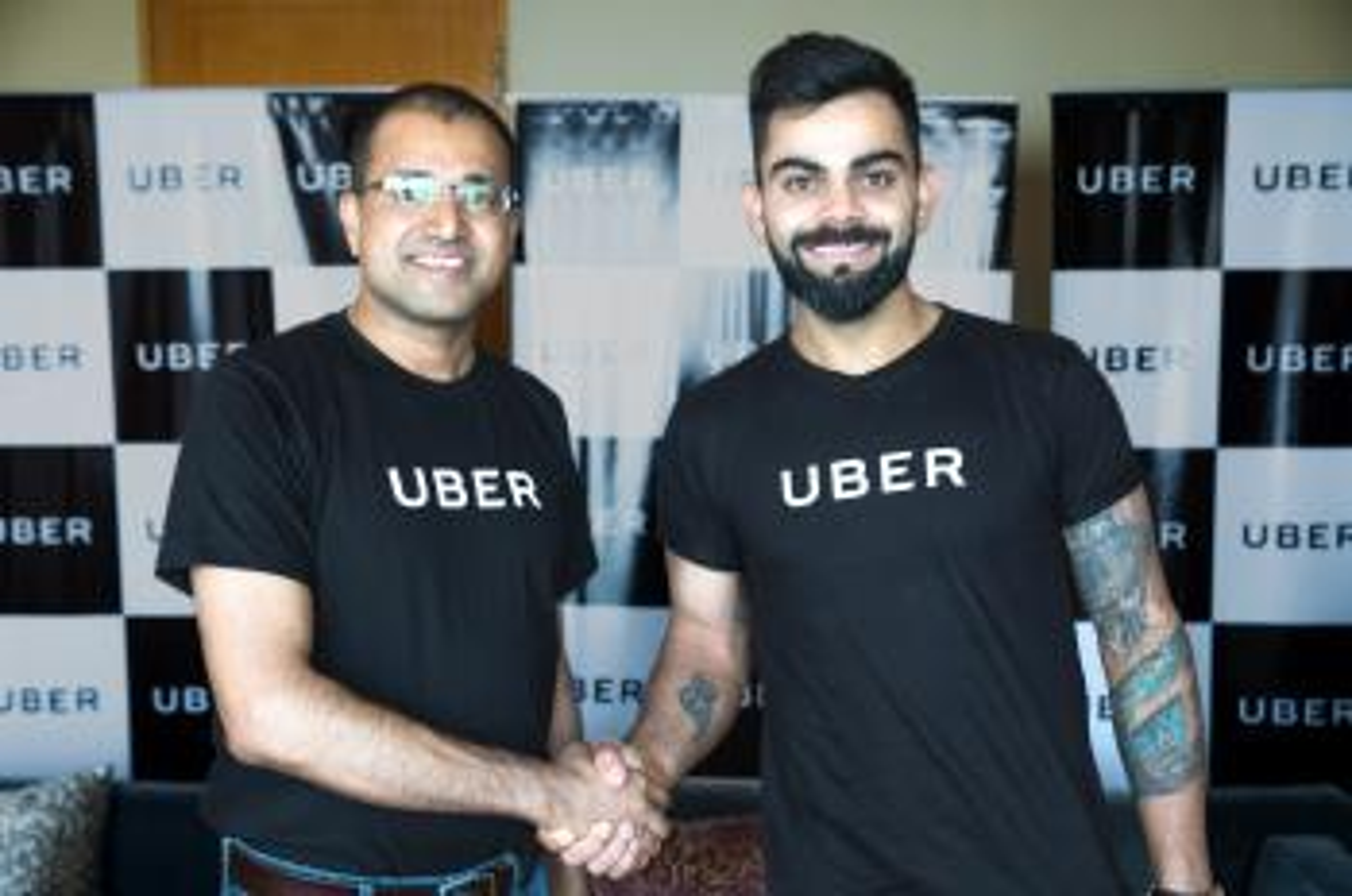 Amit Jain, President, Uber India & SA with Uber India's Brand Ambassador, Virat Kohli, Captain, Indian Cricket Team