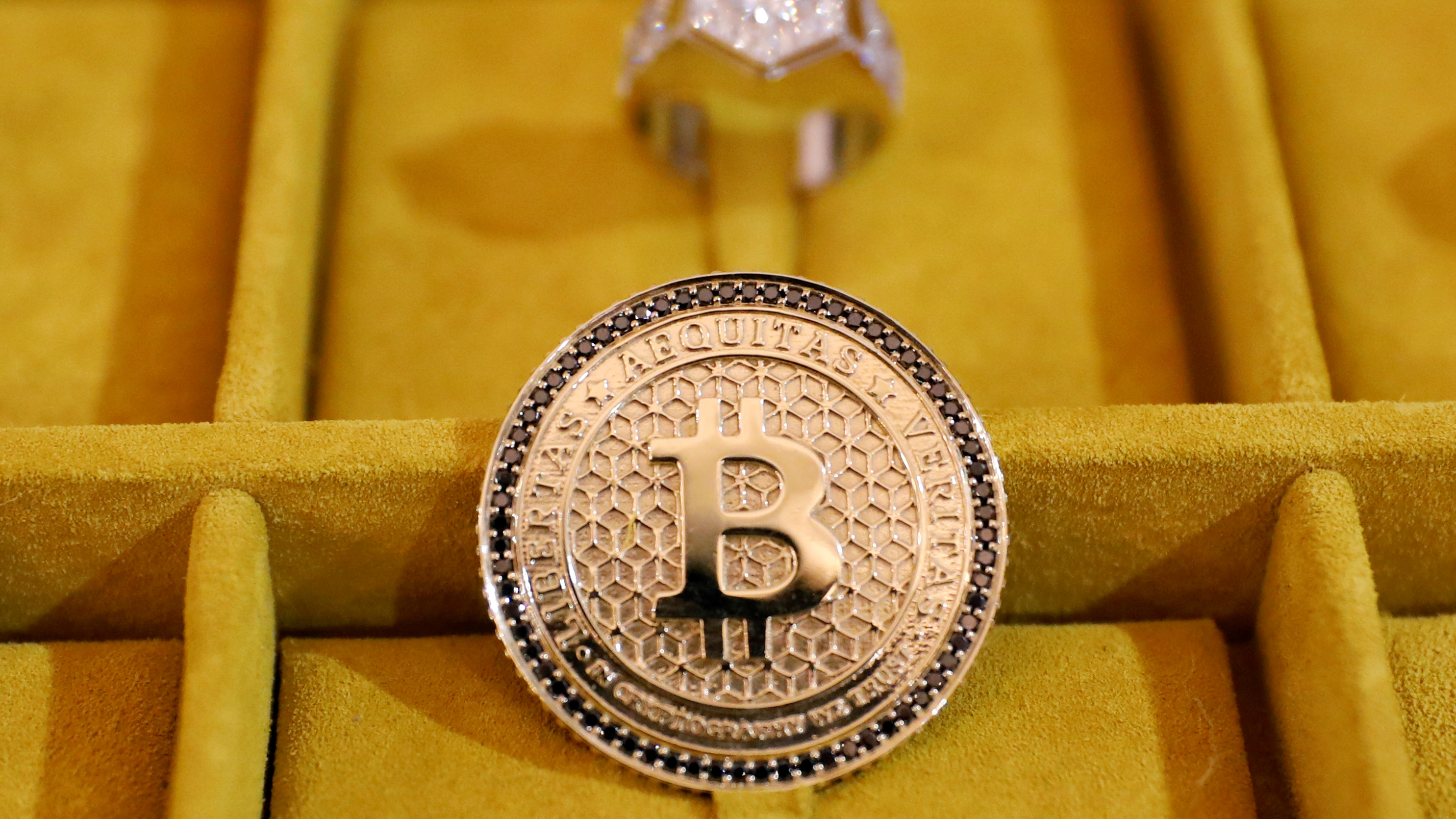 Jewelry with the Bitcoin logo.