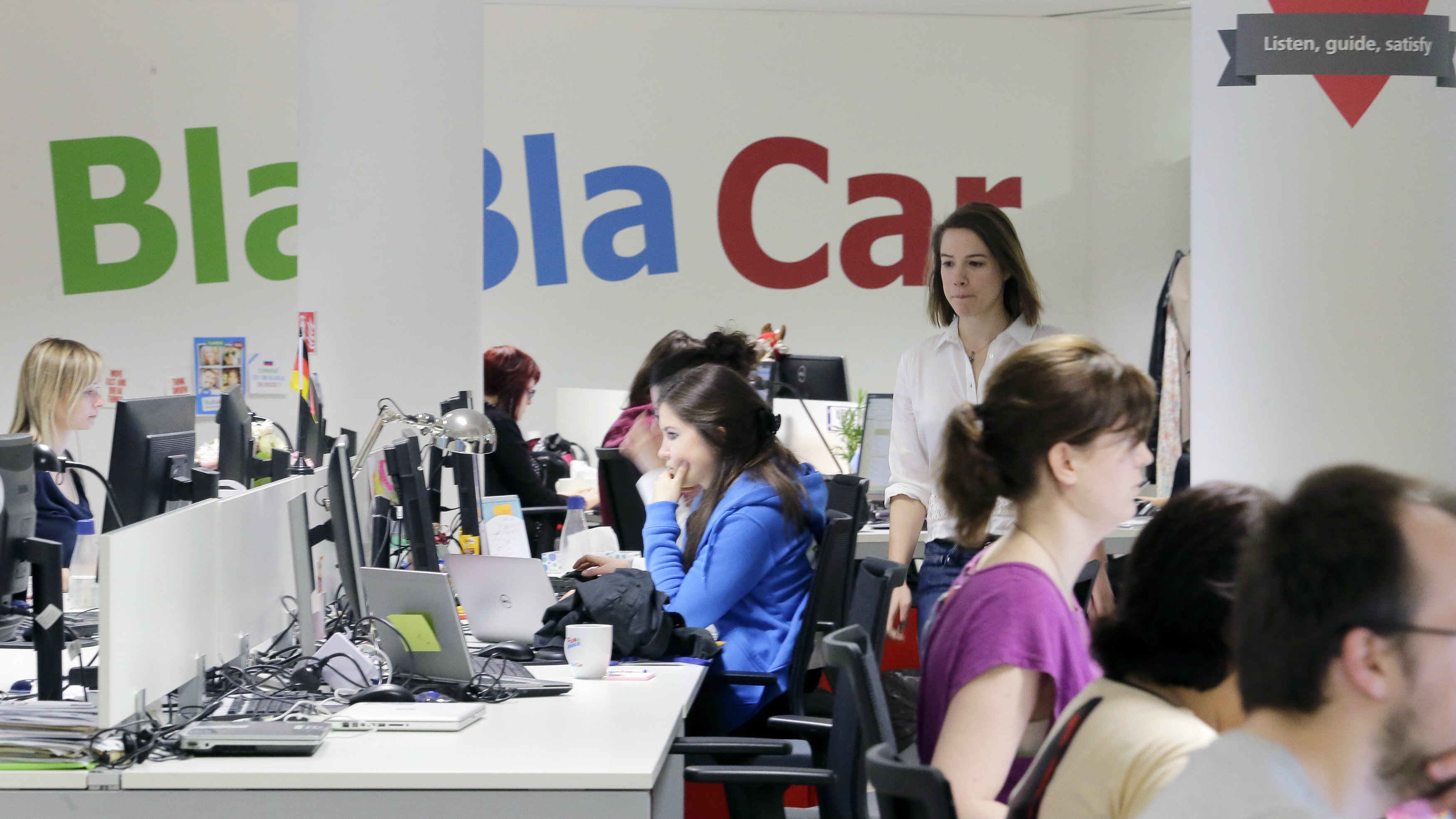 BlaBlaCar workers at the company headquarters in Paris, France, Friday, April 17 2015. French intercity ride-sharing platform BlaBlaCar said Wednesday it acquired German peer carpooling.com and Hungary-based Autohop, growing its user base to more than 20 million members.