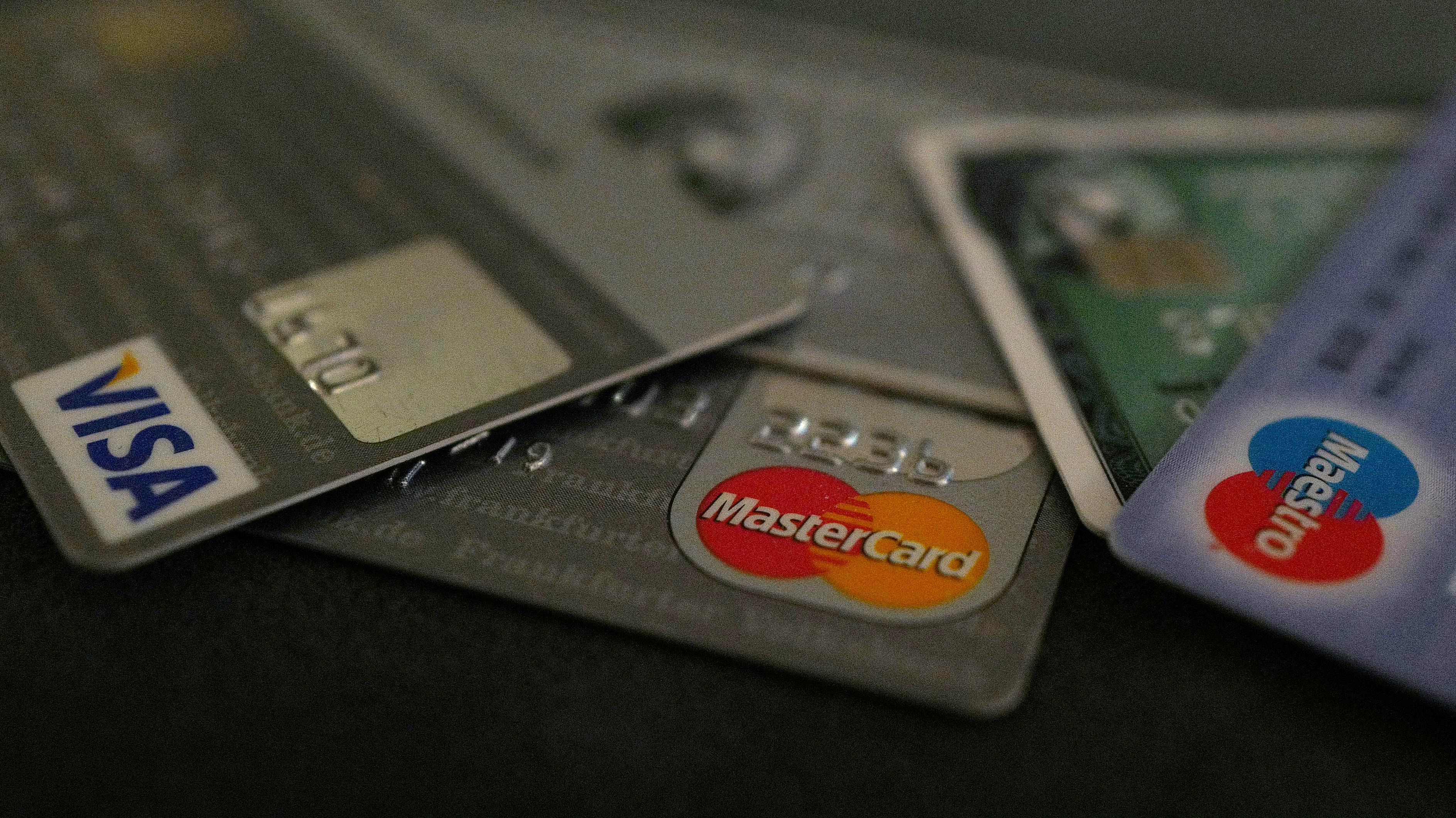 Bank debit and credit cards are photographed in this illustration picture at an office in Frankfurt, Germany, March 17, 2016.