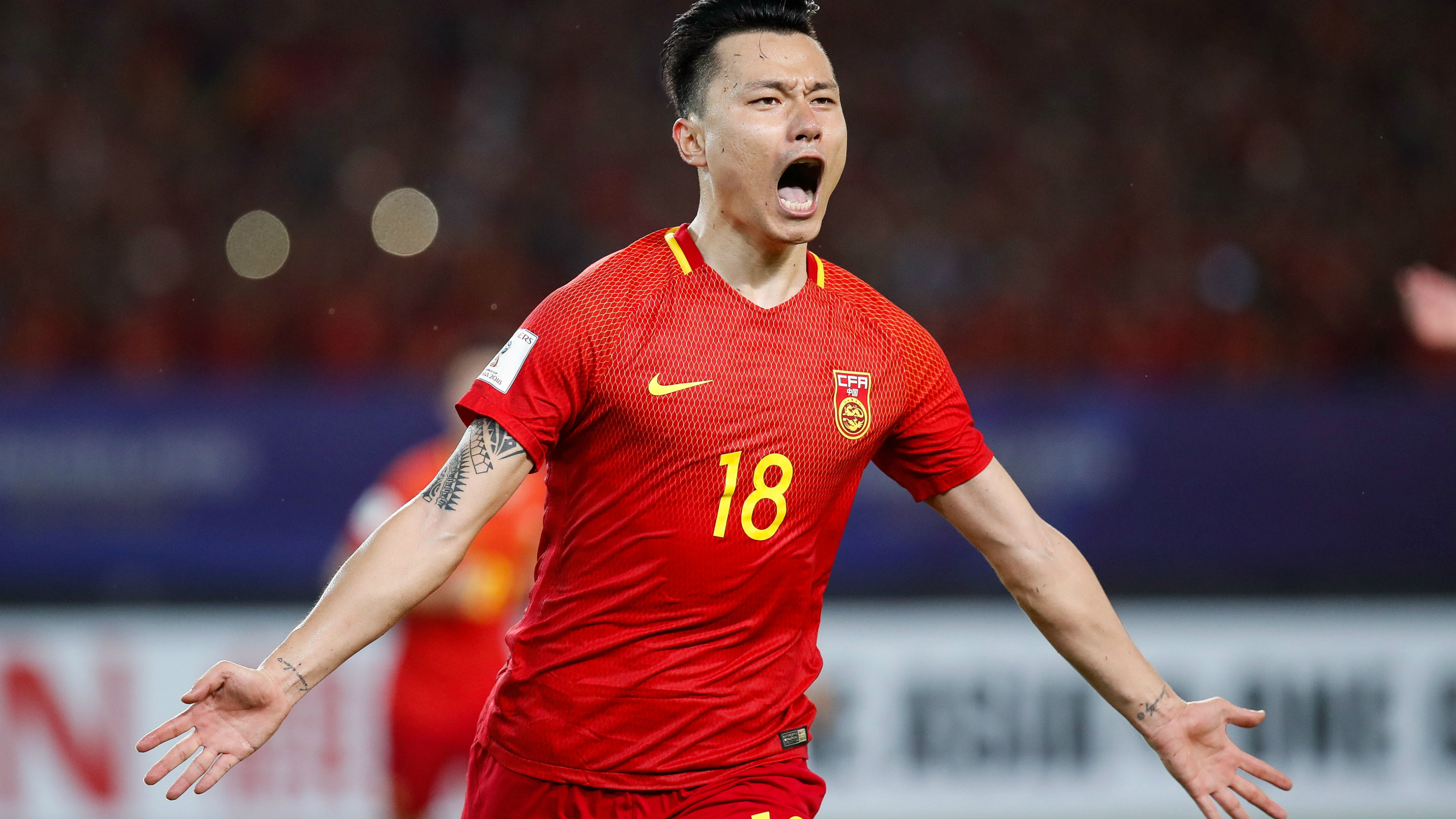 Gao Lin of China celebrates after scoring a goal from the penalty spot.