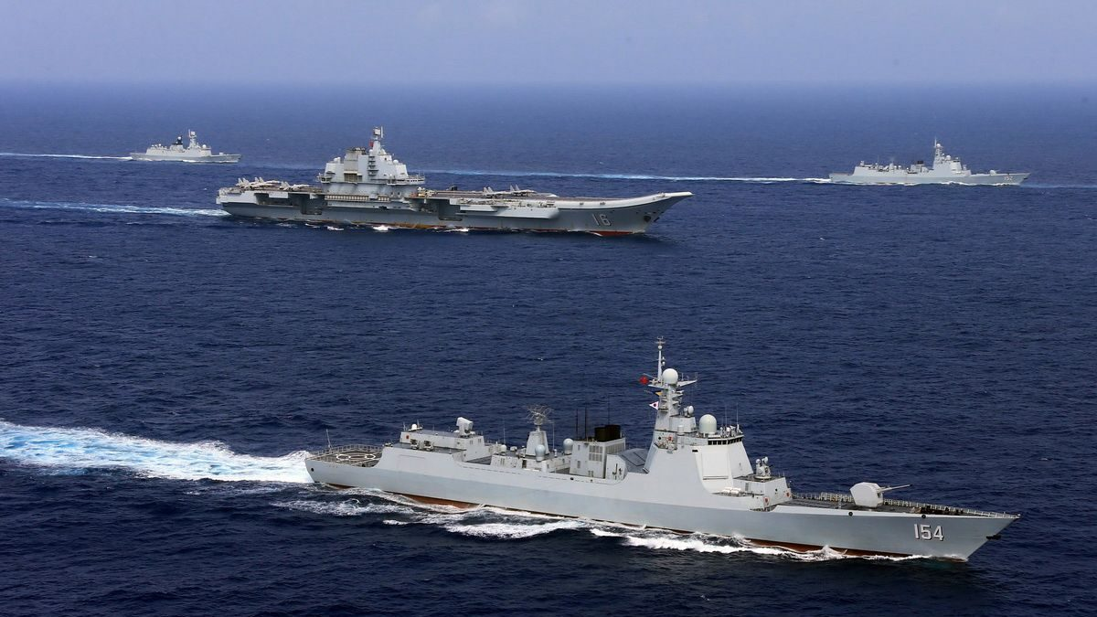 China's aircraft carrier Liaoning (C) takes part in a military drill of Chinese People's Liberation Army (PLA) Navy in the western Pacific Ocean, April 18, 2018. Picture taken April 18, 2018.