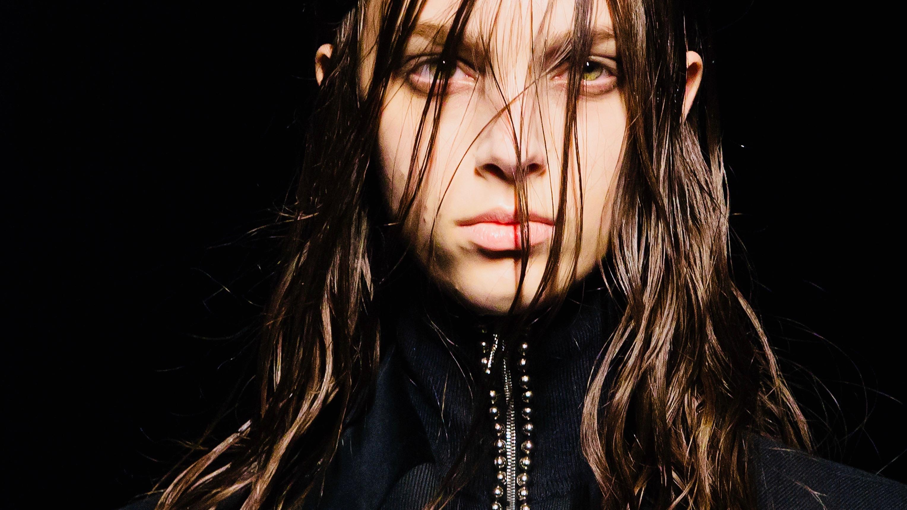 Alexander Wang model with disheveled hair.