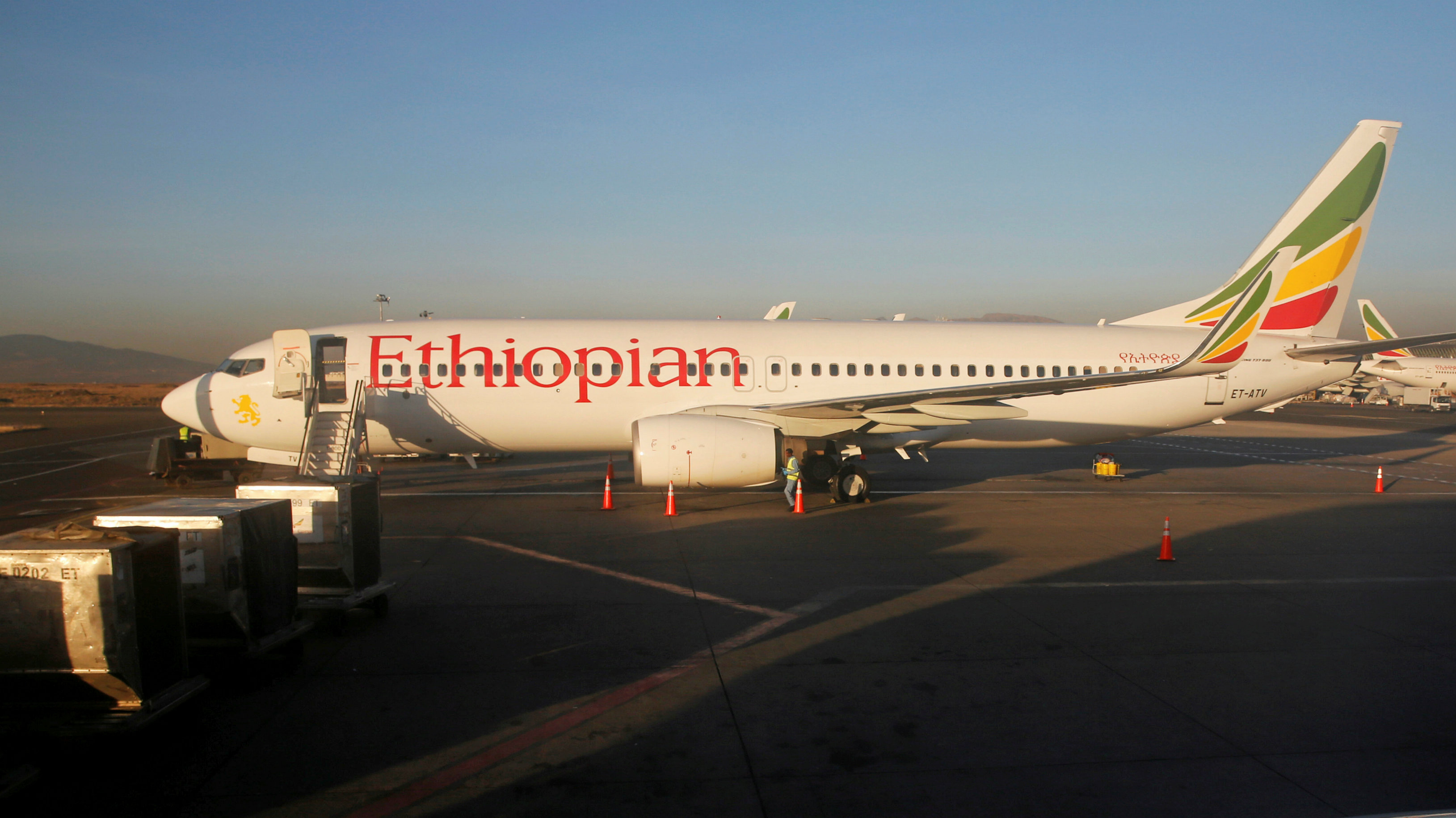 Workers service an Ethiopian Airlines Boeing 737-800 plane at the Bole International Airport in Ethiopia's capital Addis Ababa, January 26, 2017.