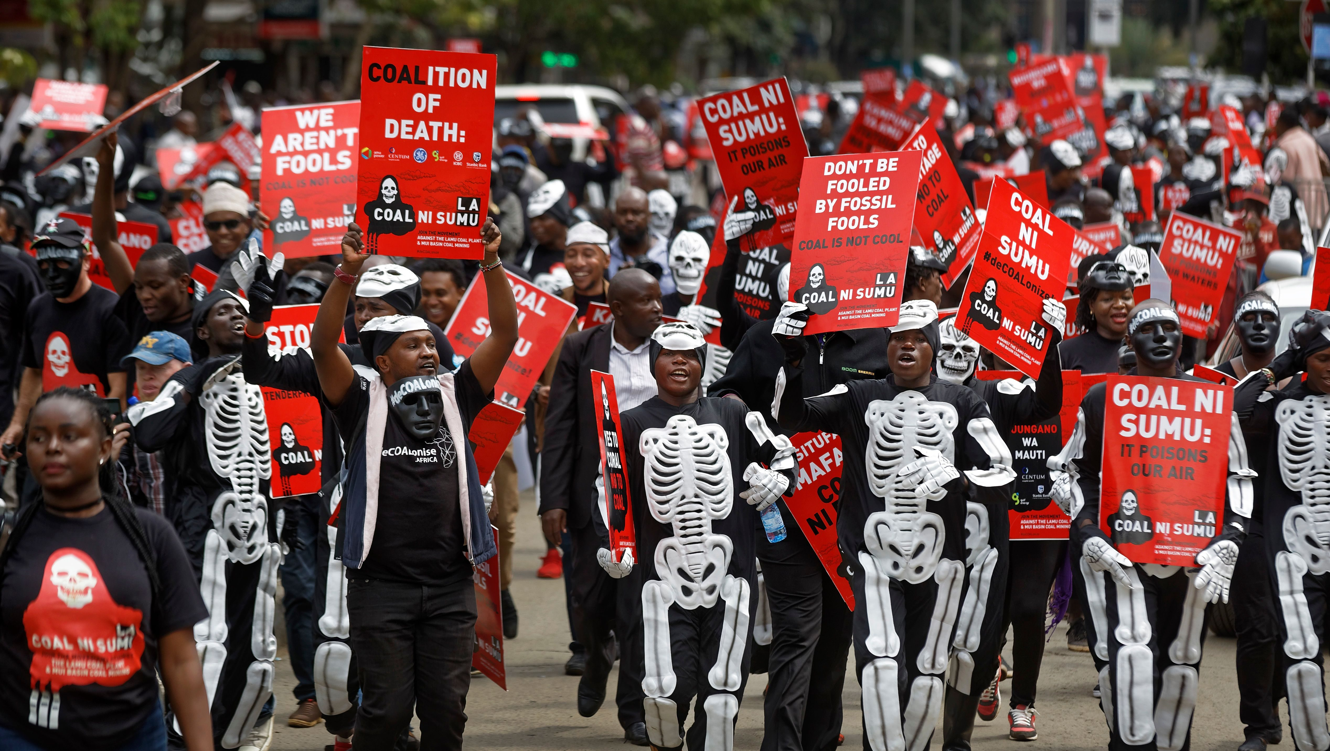 Environmental protesters demonstrate against recent government plans to mine coal and open a coal-fired power plant, in downtown Nairobi, Kenya Tuesday, June 5, 2018. Kenyan activists protested plans for the joint venture between the Kenyan and Chinese governments in Lamu County, saying it will have devastating effect on the environment and health of local populations.