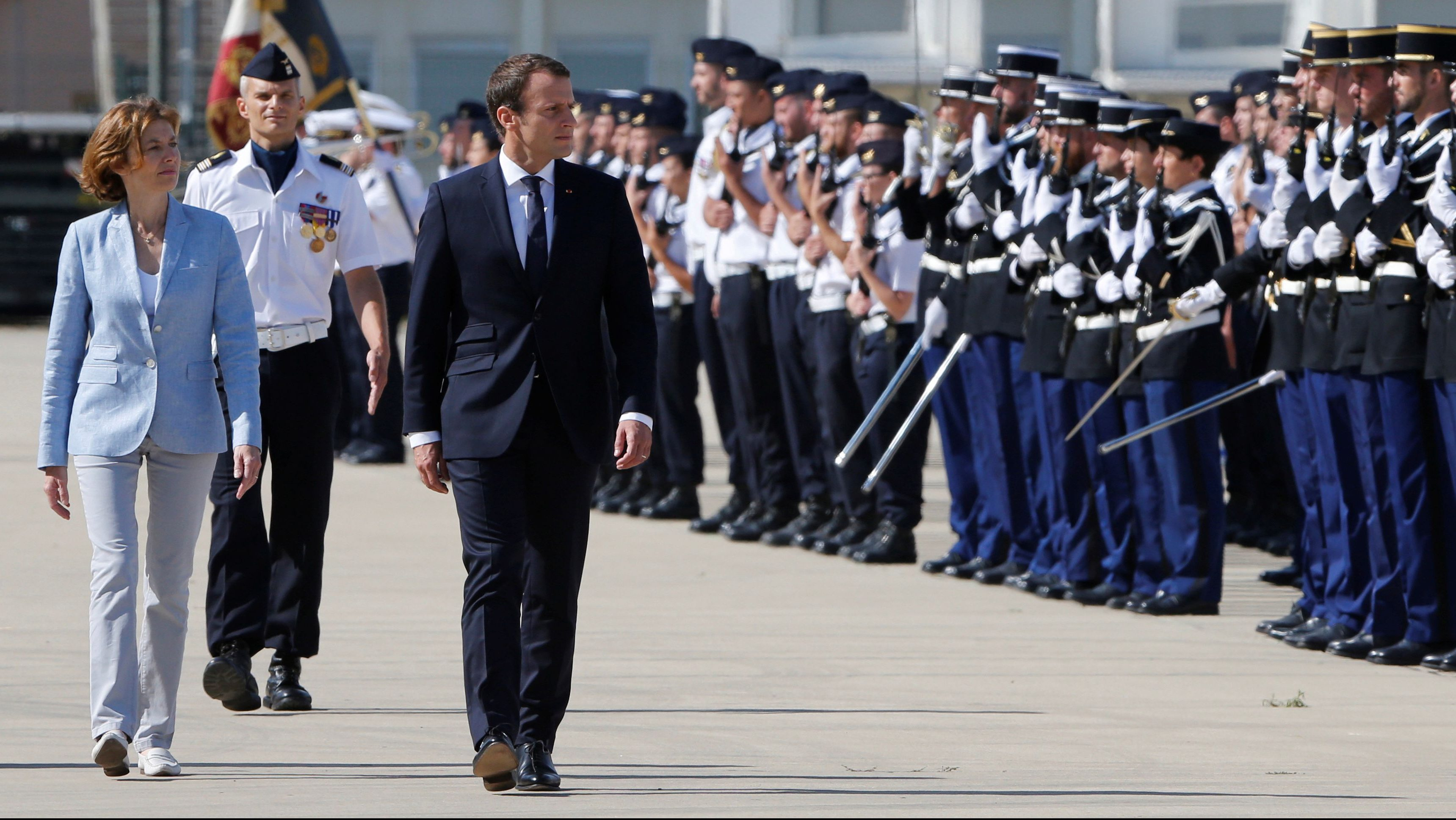 French President Emmanuel Macron reviews troops as he arrives at the military base in Istres