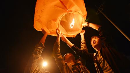 "Students launch a Kongming lantern asking for success in the upcoming national college entrance exam, or ""gaokao"", in Luan, Anhui province, China June 1, 2018."