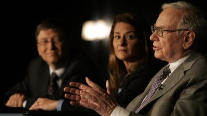 Bill Gates, left, Melinda Gates and Warren Buffett speak during a press conference Monday, June 26, 2006 in New York.