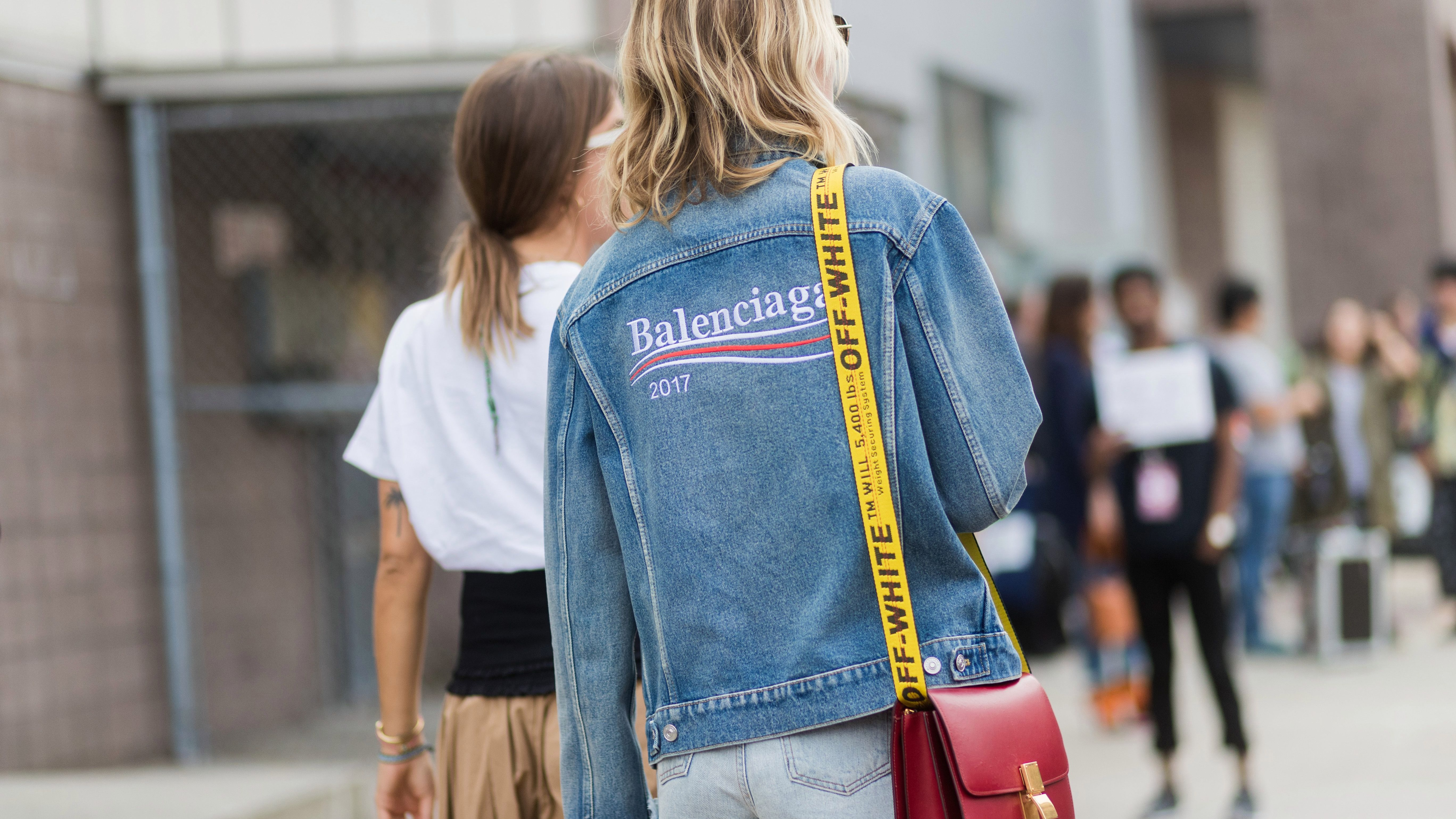NEW YORK, NY - SEPTEMBER 12: A guest wearing Off White bag, Balenciaga denim jacket seen in the streets of Manhattan outside Coach during New York Fashion Week on September 12, 2017 in New York City. (Photo by Christian Vierig/Getty Images)