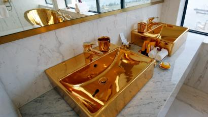 gold bathroom sink in a hotel