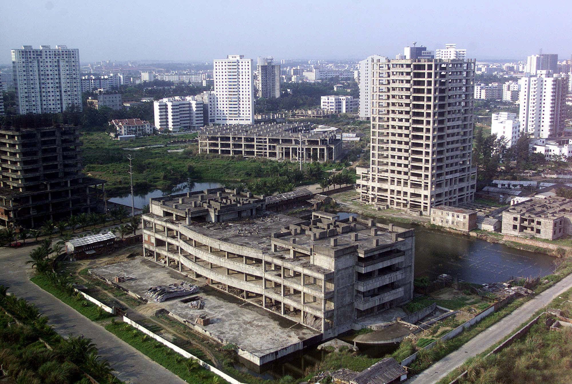 More than 150 buildings were left derelict after a real estate bubble collapsed in 1993 in Haikou, the capital city of Hainan.