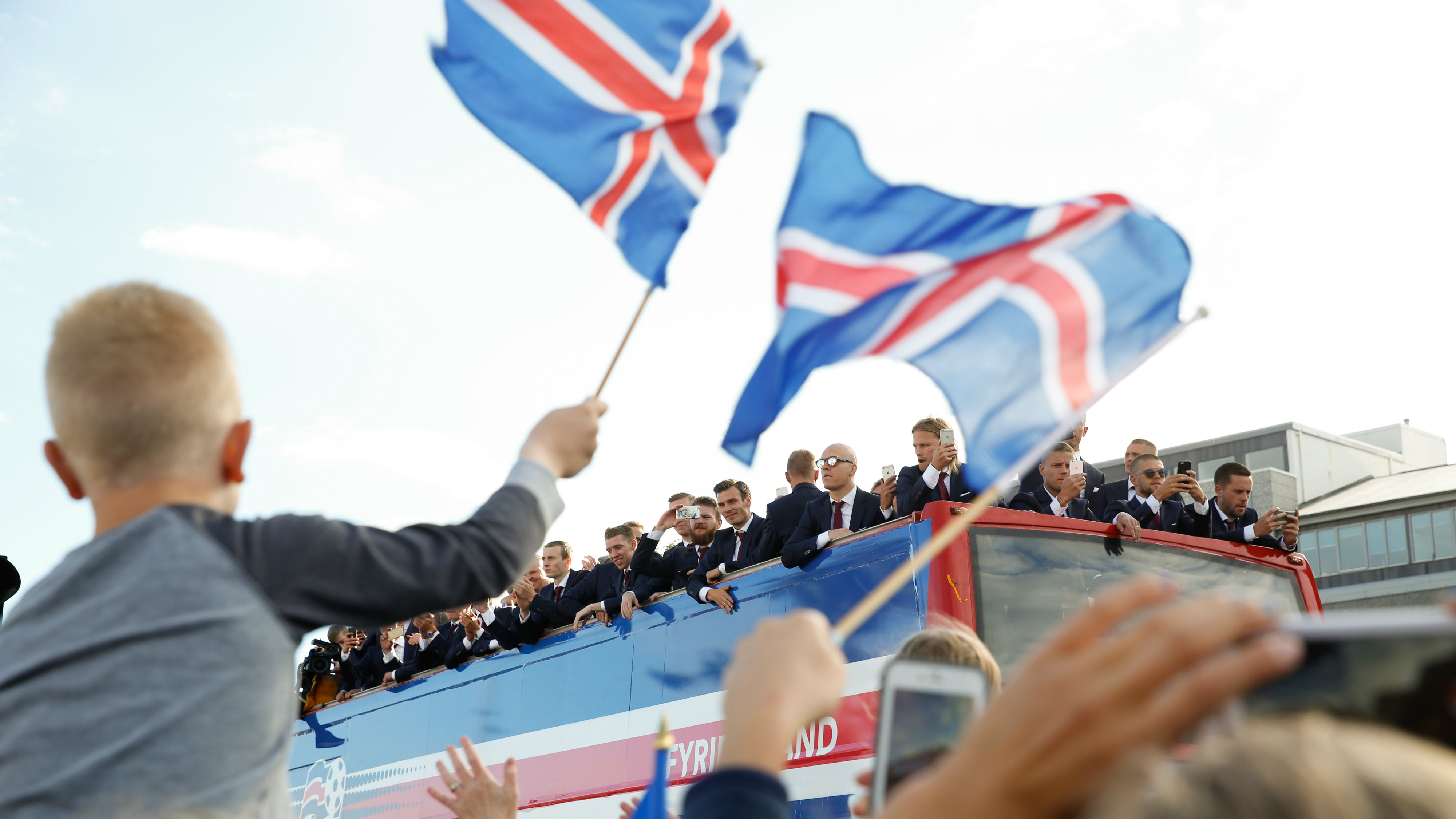 Icelandic soccer fans celebrate as their national team comes home to a hero's welcome from the Euro 2016 soccer championships in Reykjavik, Iceland, Monday July 4, 2016.
