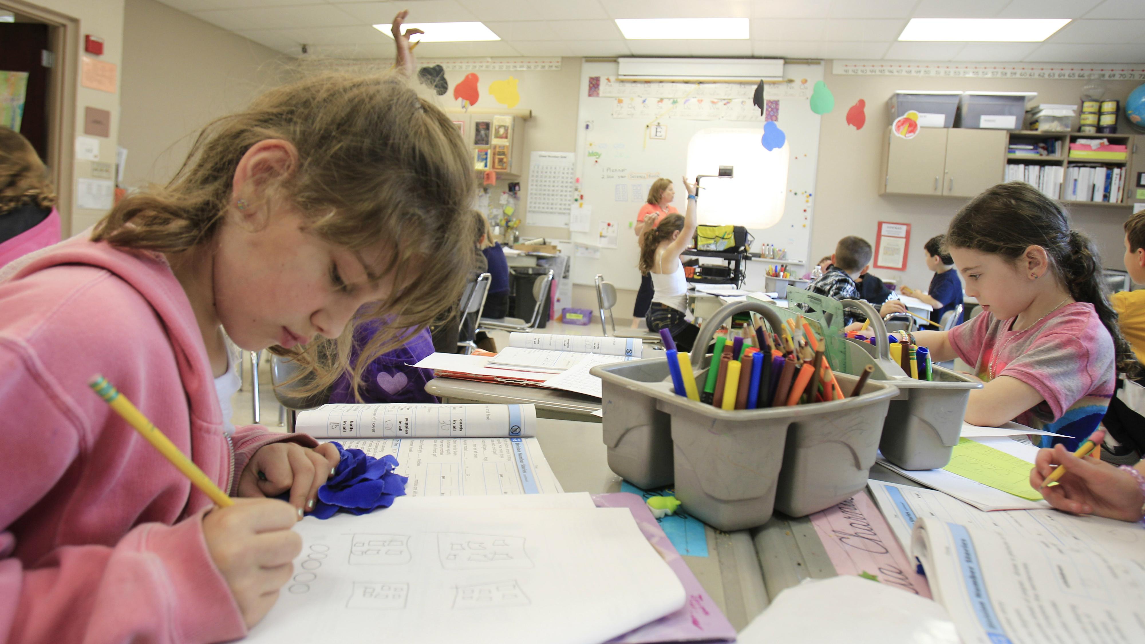 Kids studying math at school.
