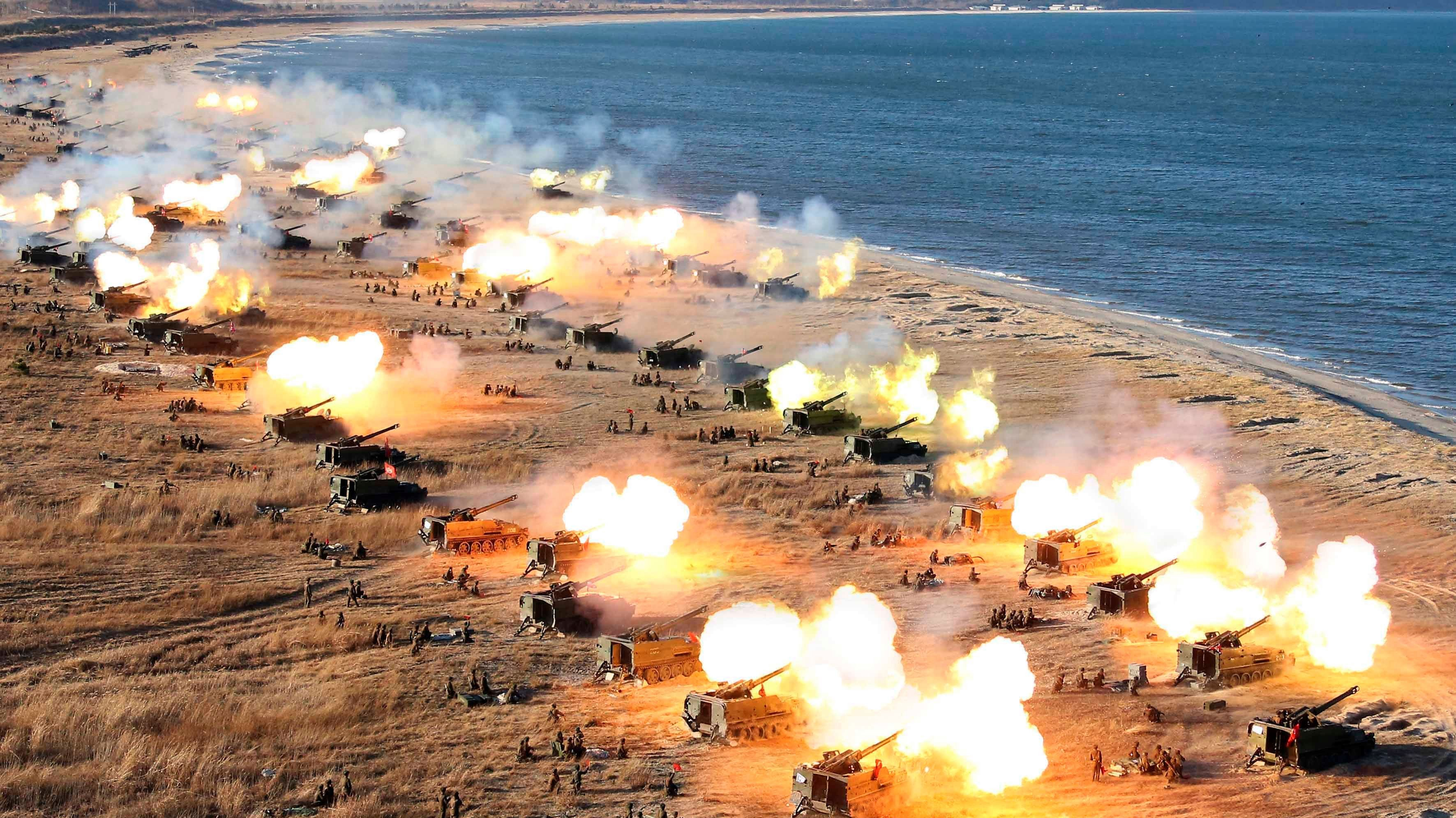 A general view shows a drill by North Korean Korean People's Army (KPA) artillery units on the front in this image released by North Korea's Korean Central News Agency (KCNA) in Pyongyang December 2, 2016.