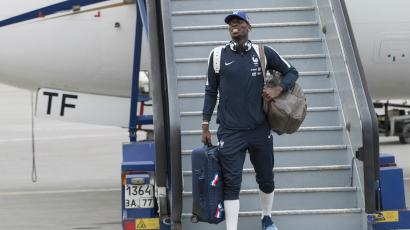 The soccer player Paul Pogba getting off a plane.