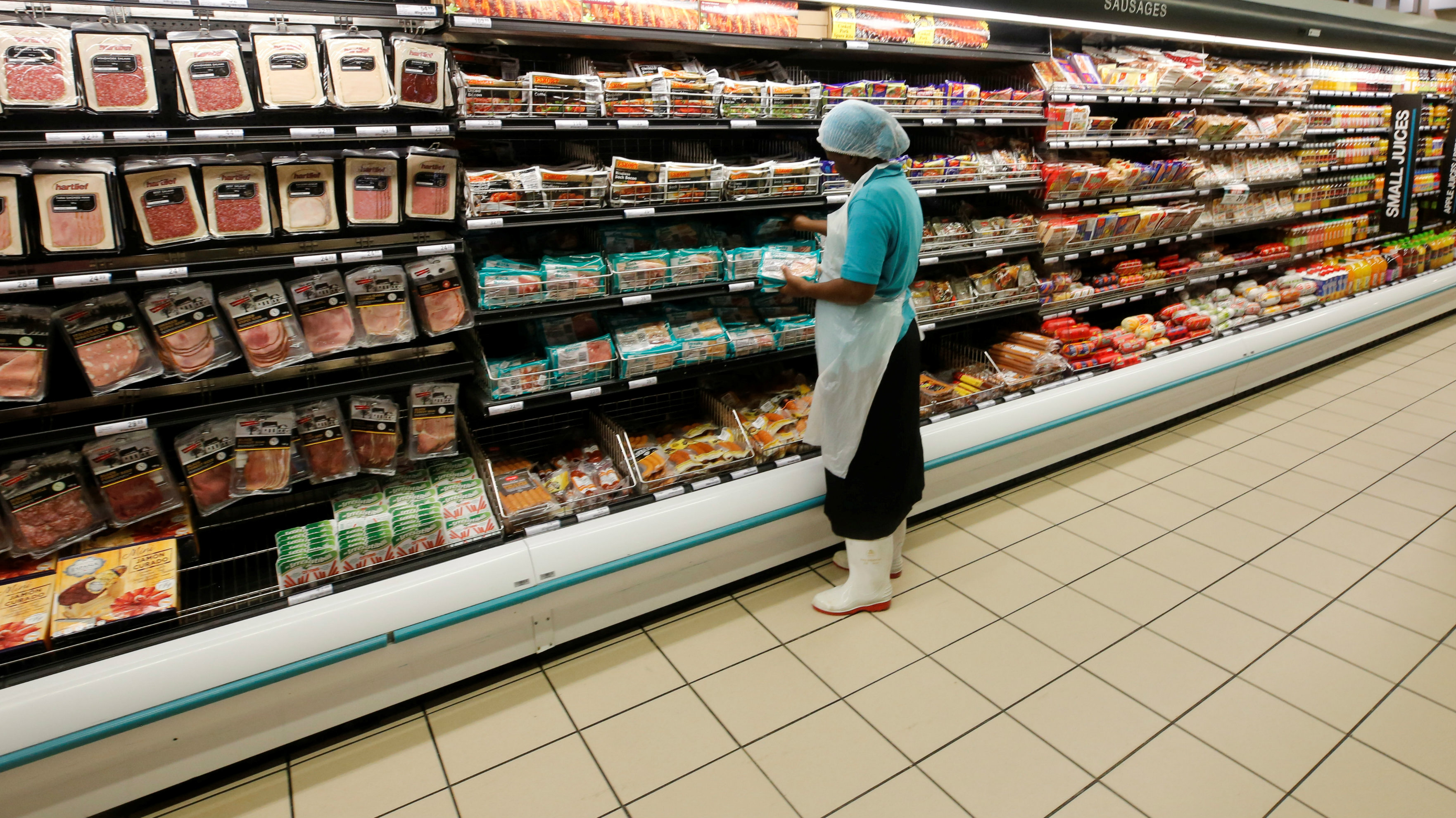 A worker packs cold meats at an outlet of retailer Shoprite Checkers in Cape Town, South Africa, June 15, 2017. Picture taken June 15, 2017.