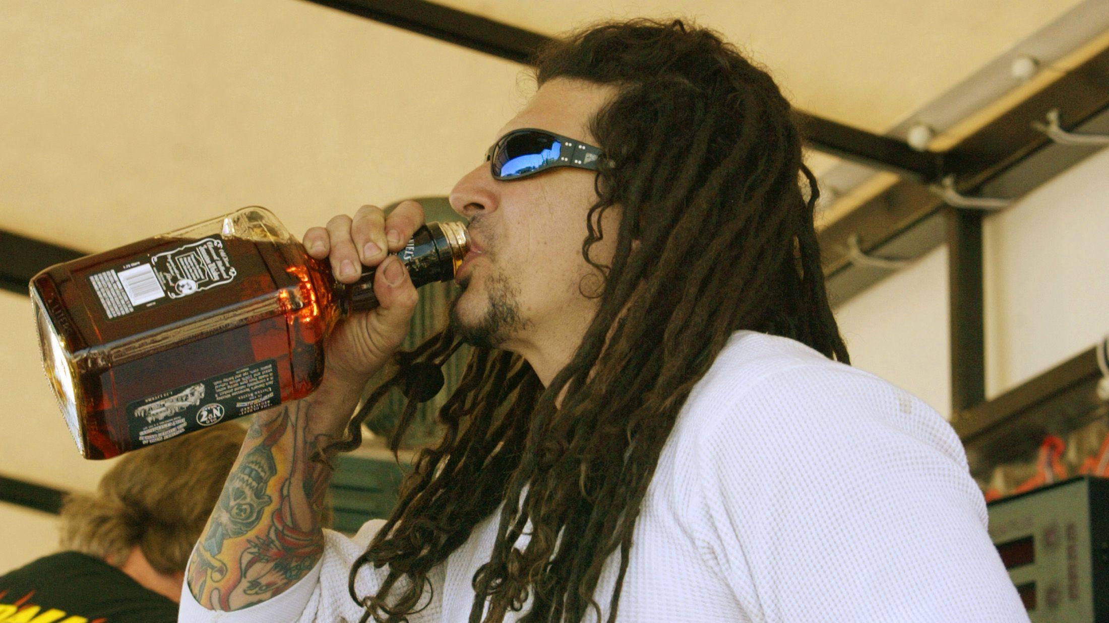 Billy Lane drinks whiskey on Main Street at Bike Week.