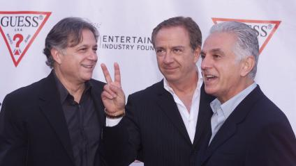 The brothers Marciano, Guess? clothing line founders Armand, Paul, and Maurice Marciano in 2002.