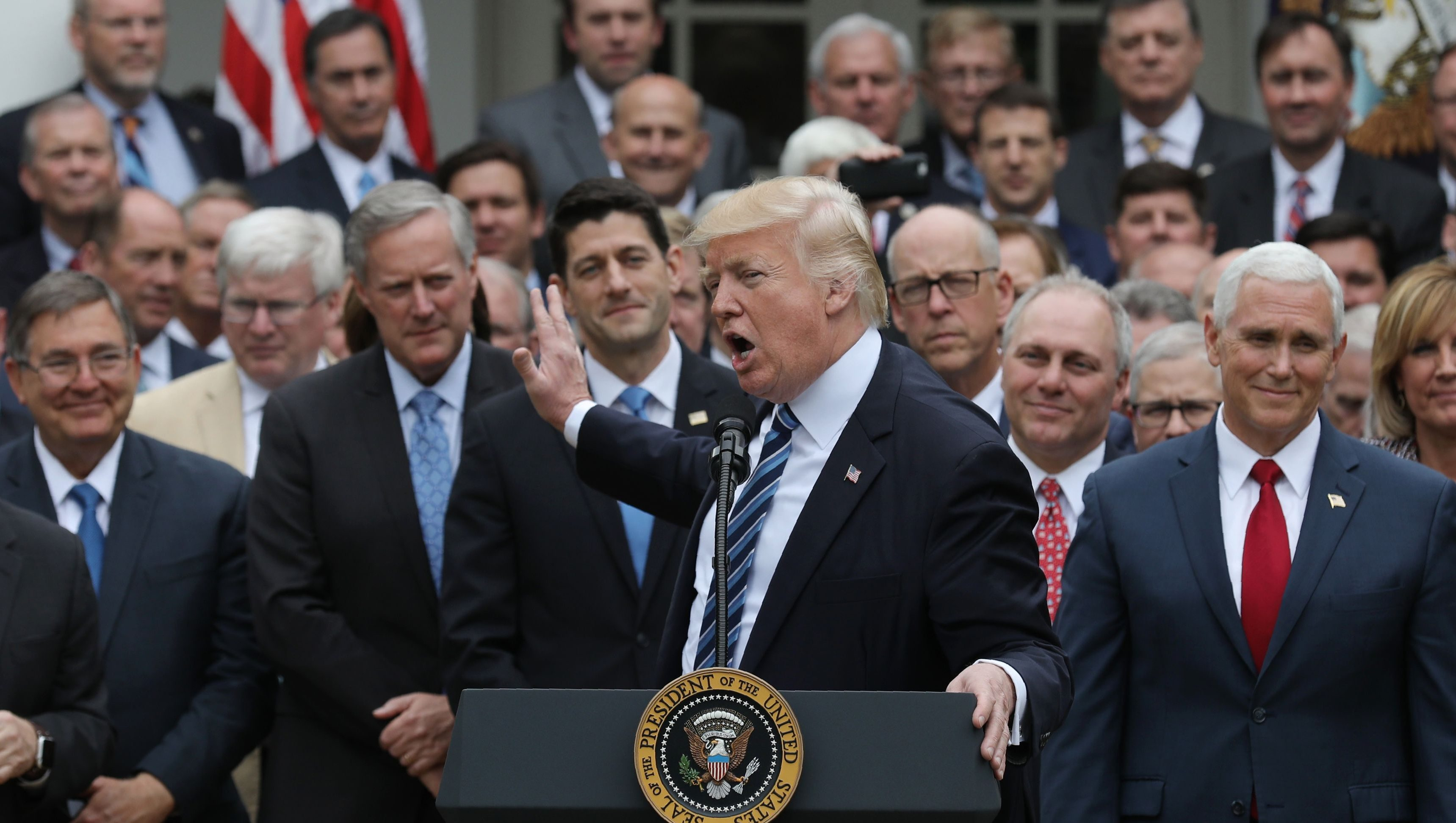 U.S. President Donald Trump (C) acknowledges House Freedom Caucus leader Rep. Mark Meadows (R-NC) (3rdL) as he gathers with Congressional Republicans in the Rose Garden of the White House after the House of Representatives approved the American Healthcare Act, to repeal major parts of Obamacare and replace it with the Republican healthcare plan, in Washington, U.S., May 4, 2017. REUTERS/Carlos Barria - HP1ED541IYN0S