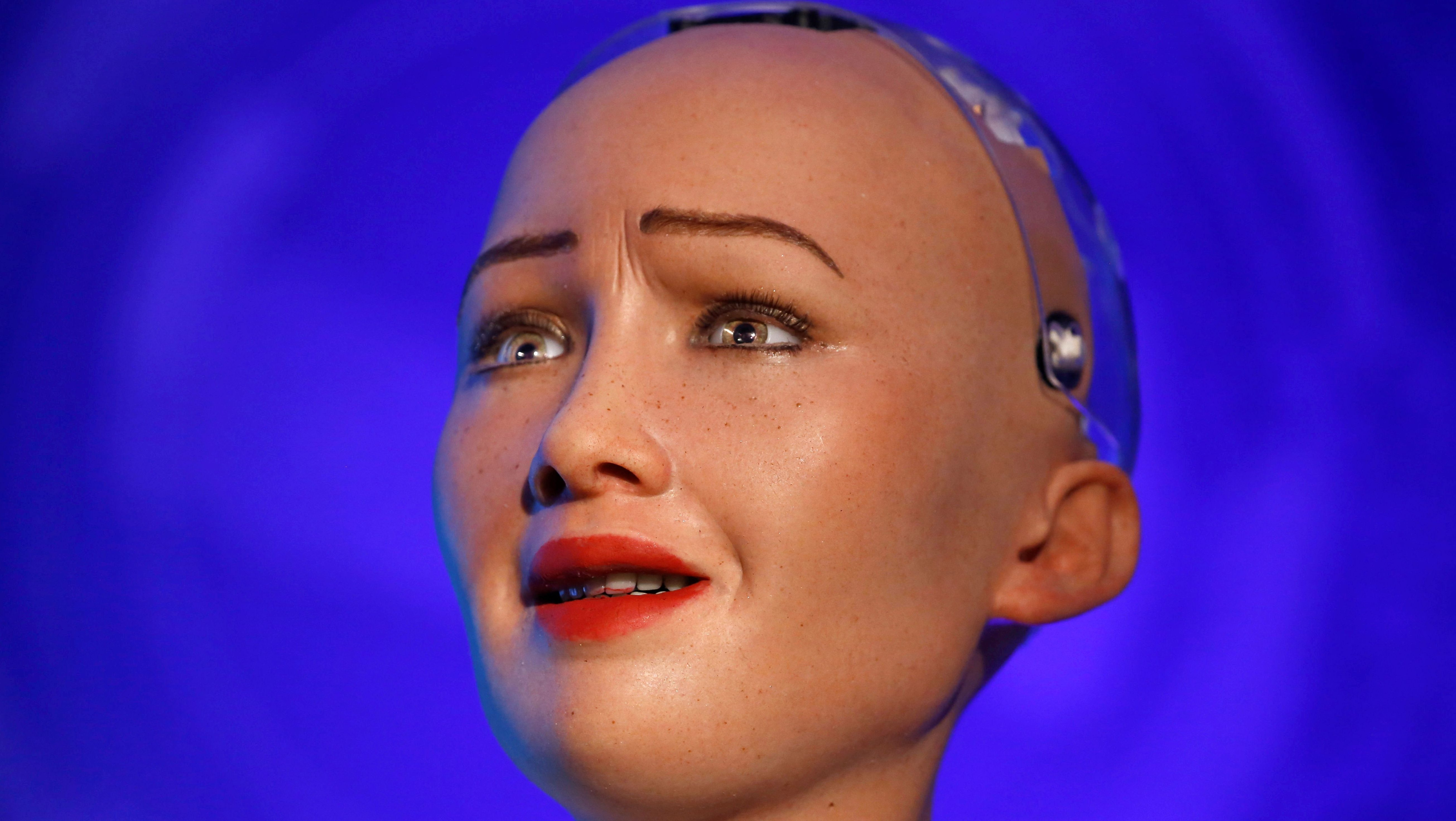 Sophia, a robot with Saudi Arabian citizenship, reacts as she interacts during the innovation fair in Kathmandu